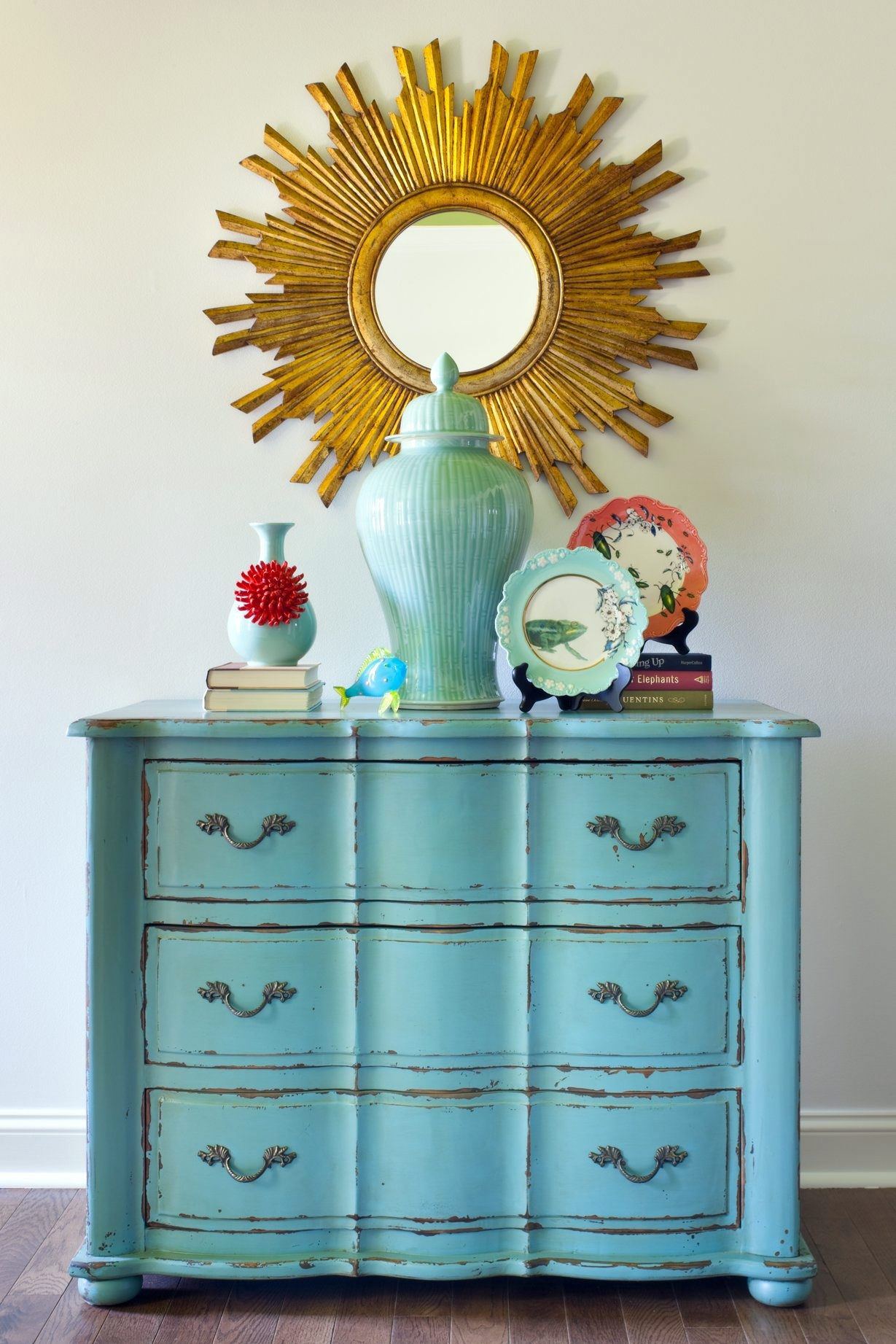 Pair a regal mirror with a rustic chest of drawers for an updated look.