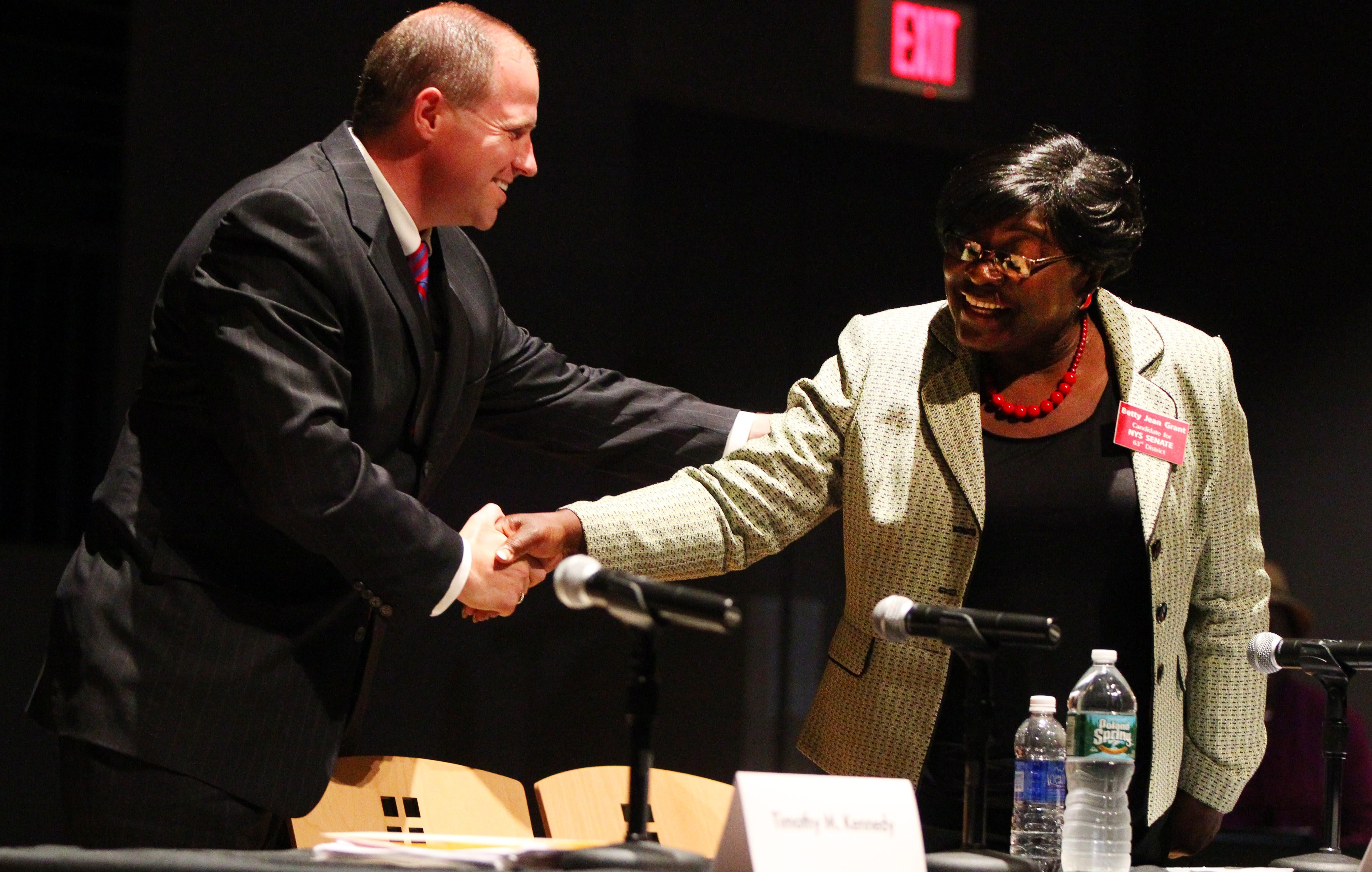 State Sen. Tim Kennedy shakes hands with candidate Betty Jean Grant after their debate in Burchfield Penny Art Center in Buffalo on Tuesday.