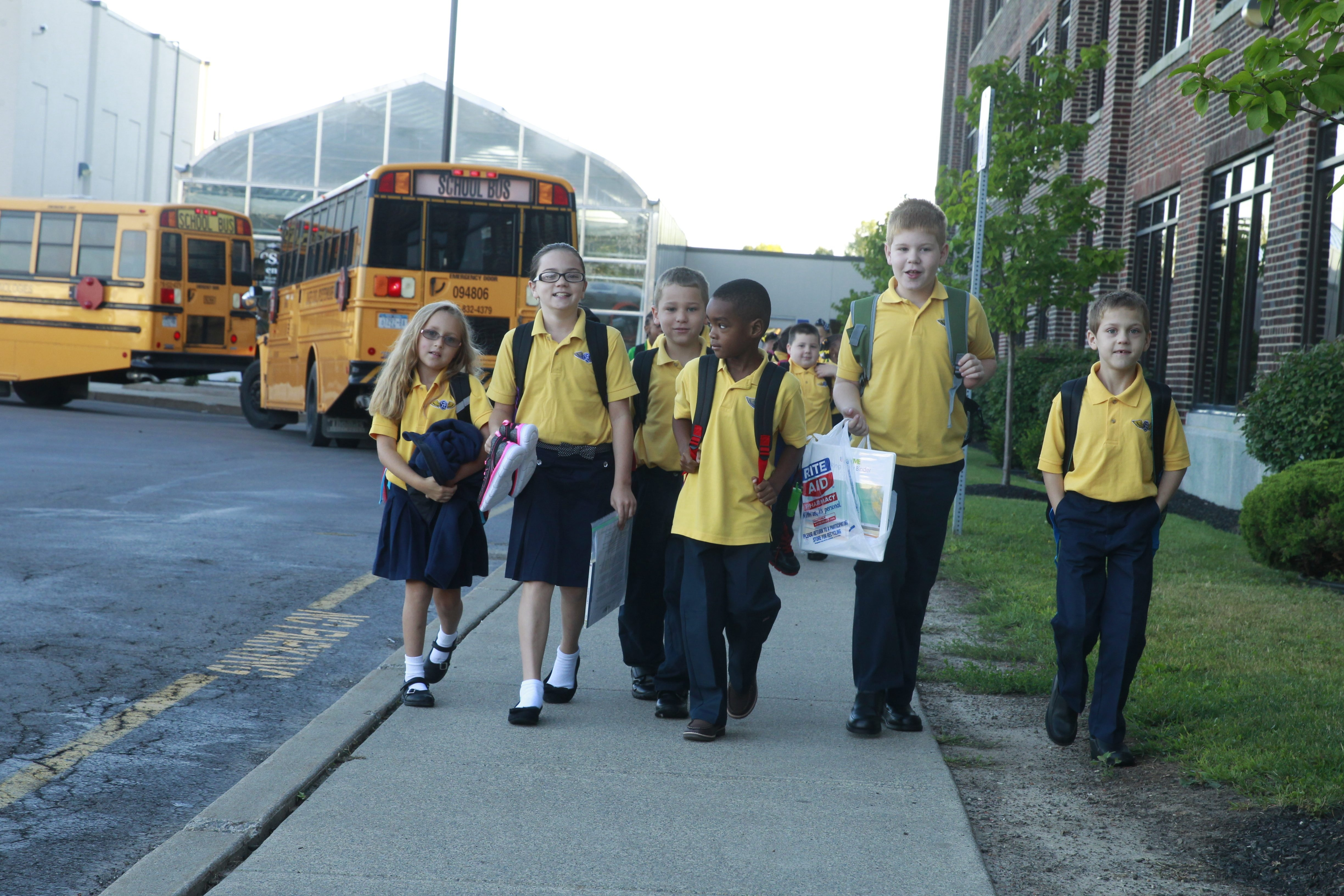 Children arrive on buses for the first day of school Monday at the Charter School for Applied Technologies on Kenmore Avenue in the Town of Tonawanda.