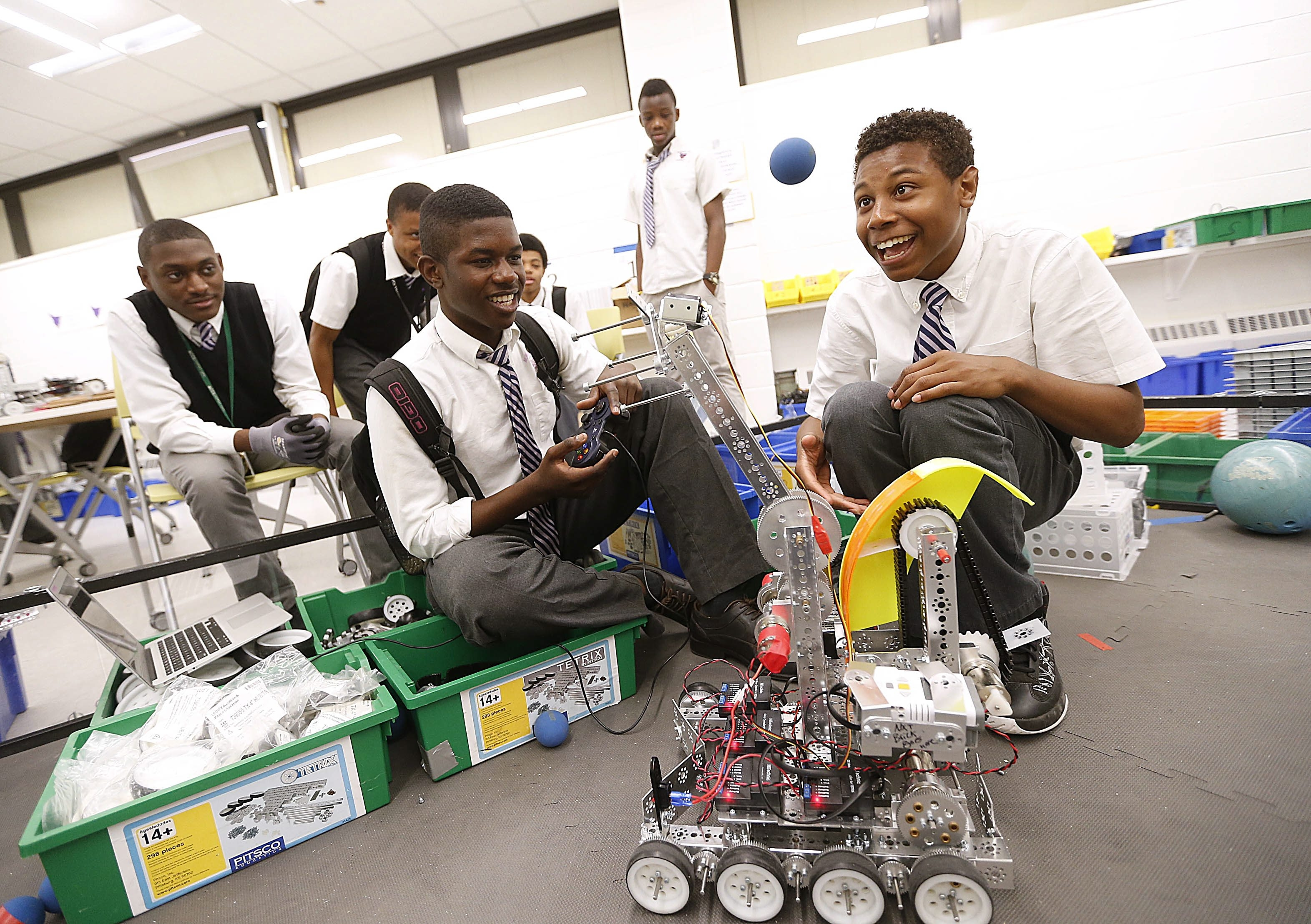 At top, 10th-graders Sendes Dhaiti, Daniel Dumbard and Duvonne Frails build a robot in one of the career programs at Newark Tech High School. Elsewhere in the district, students create music videos, bottom left, and work on a calculus assignment, right. The projects reflect the variety of career offerings in the district.