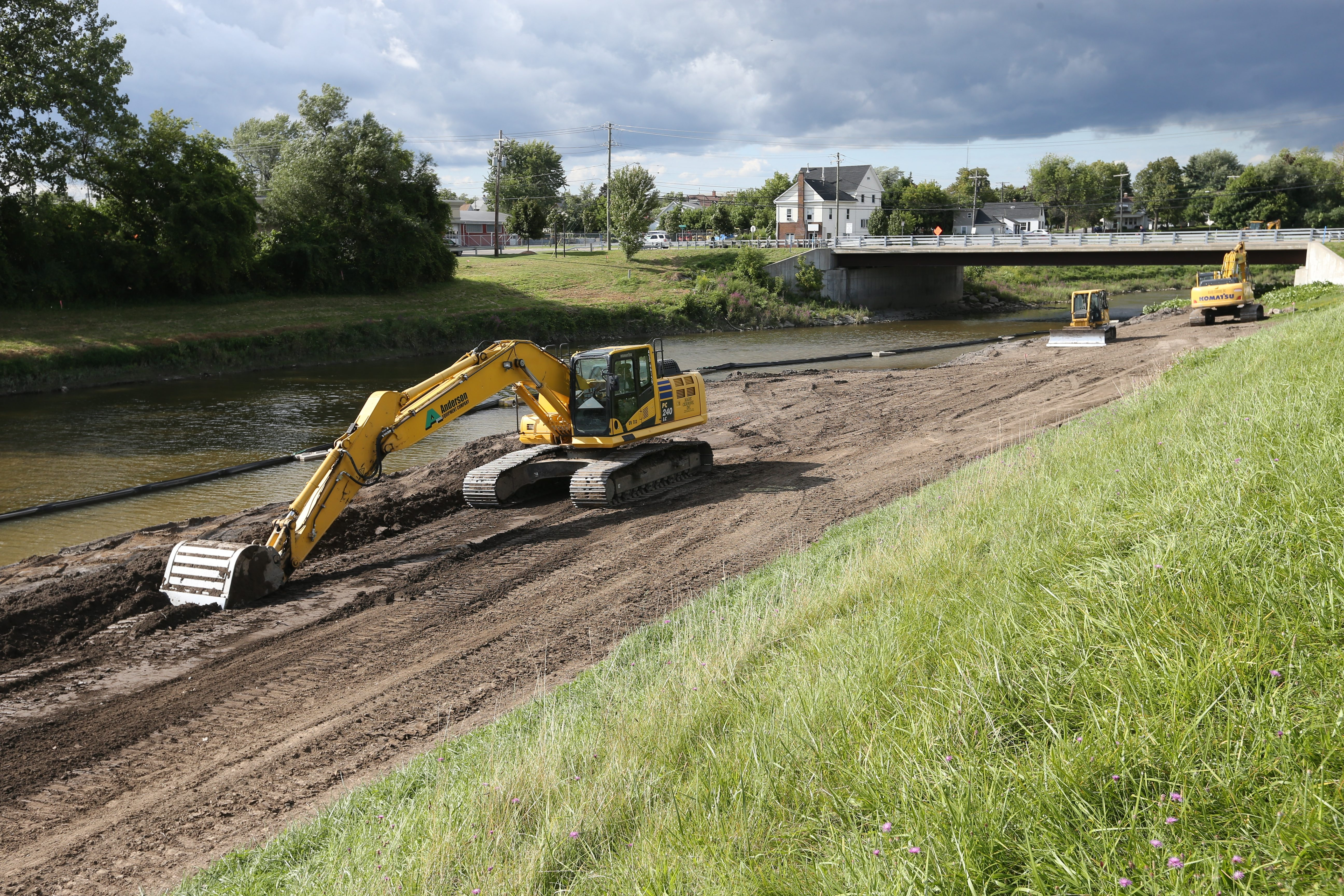 Flood prevention work is carried out along Cayuga Creek near Broadway in Lancaster on Friday.