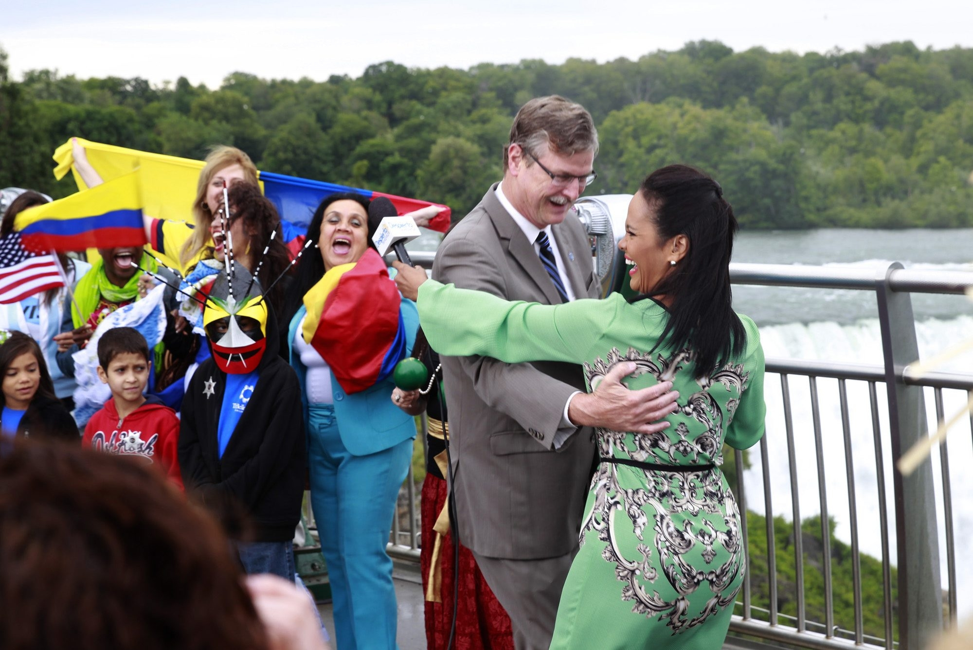 Niagara Falls Mayor Paul Dyster dances with the host of  Univiision Network's international morning show, 'Despierta America Live,' Birmania Rios as they  telecast  segments from the observation deck at Prospect Point in Niagara Falls, NY on Friday, Aug. 15, 2014.  (John Hickey/Buffalo News)