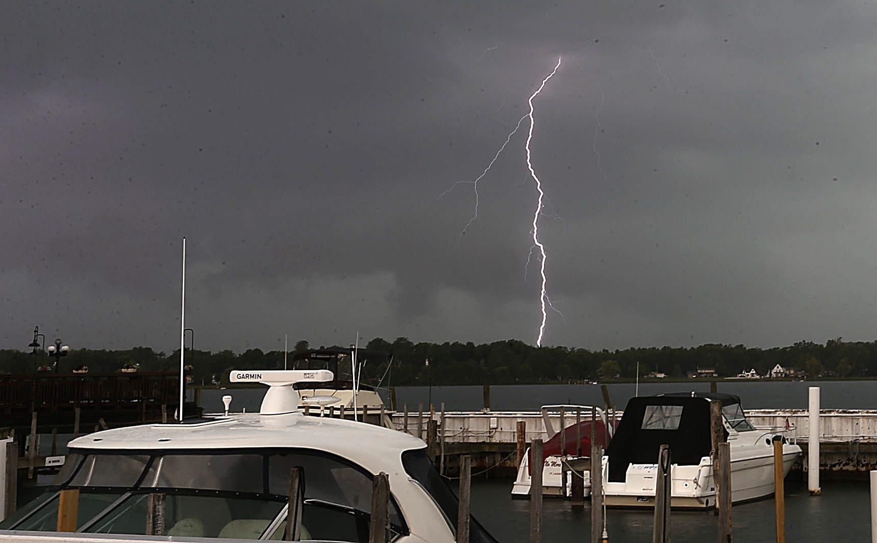 Bolts of lightning are displayed over the Niagara River near Acqua Restaurant on Niagara Street in Buffalo during the storm on Tuesday.  (Robert Kirkham/Buffalo News)