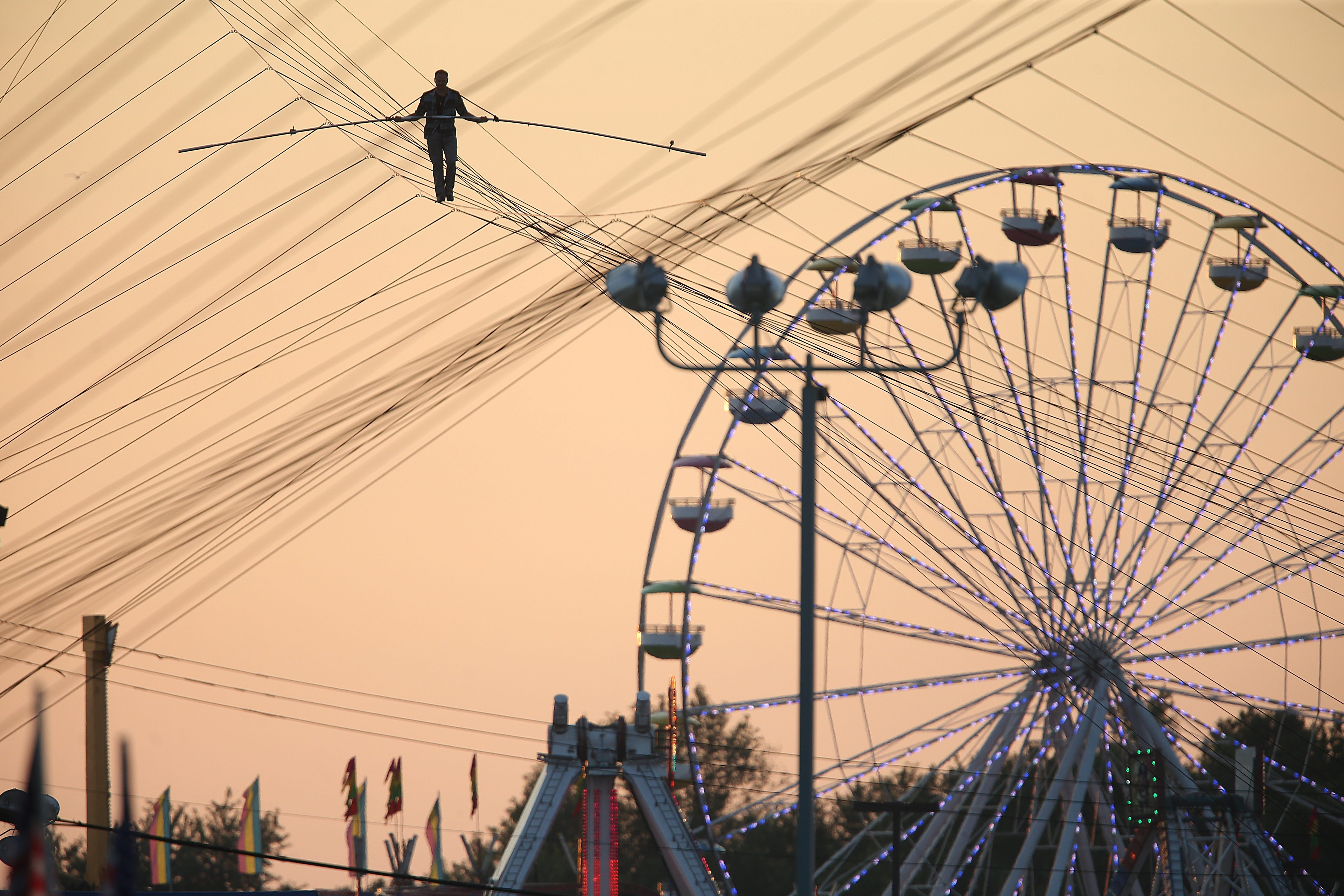 Nik Wallenda walks on the high wire at the Erie County Fair in Hamburg, Sunday, August 10, 2014. {Photo by Charles Lewis/Buffalo News}