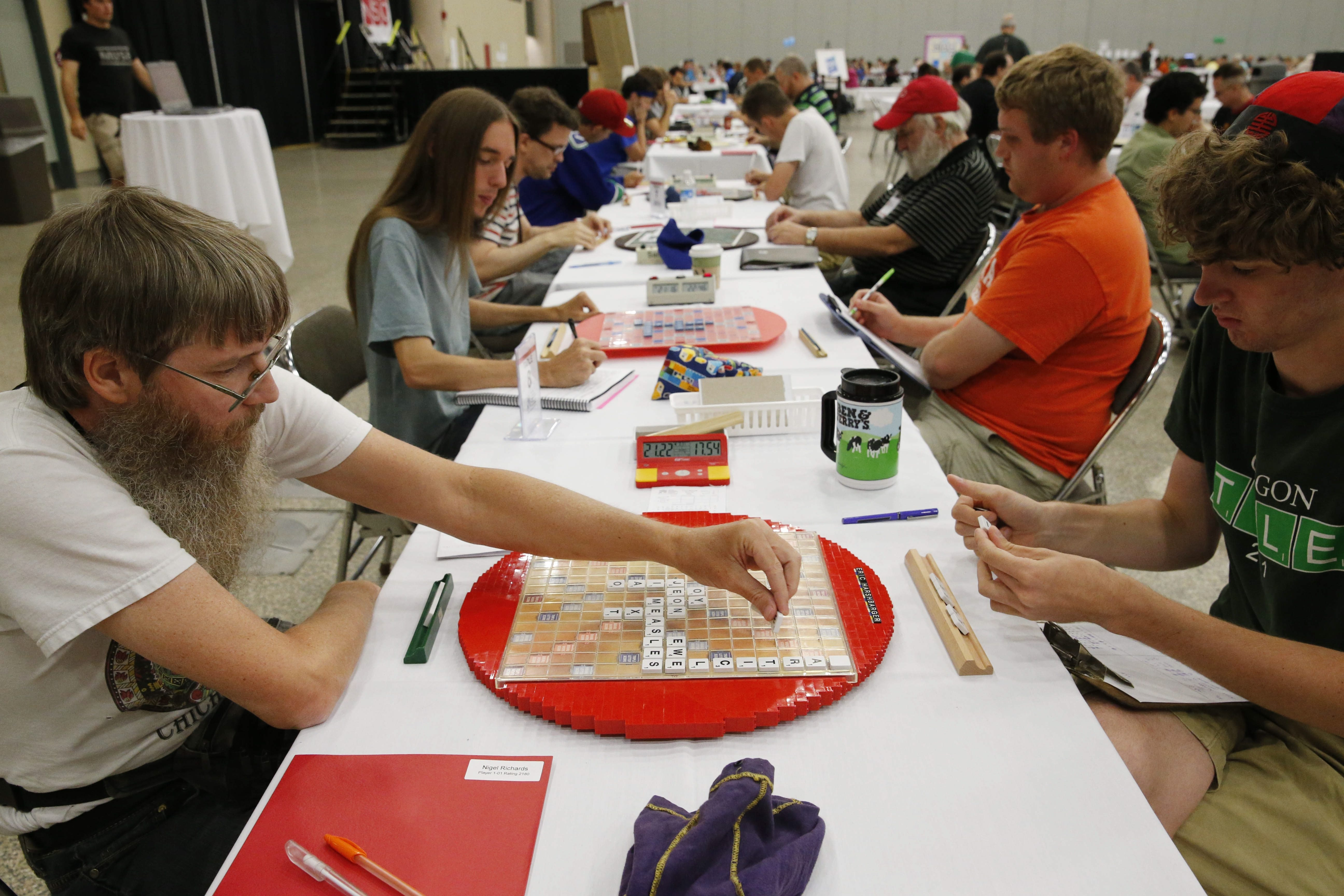Nigel Richards, left, plays a word during a game in the 25th National Scrabble Championships at the Buffalo Niagara Convention Center on Saturday. Richards, a New Zealander who lives in Malaysia, has won the past four championships.