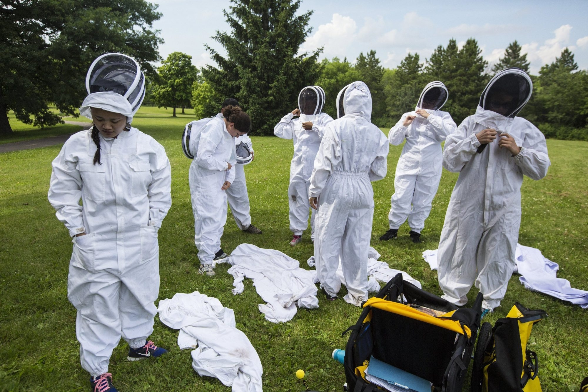 A group of people from General Mills suit up to visit a bee hive with Erin Rupp, of the Beez Kneez, as she teaches a class about bees at JD Rivers Children's Garden in Minneapolis on June 26, 2014. (Renee Jones Schneider/Minneapolis Star Tribune/MCT)