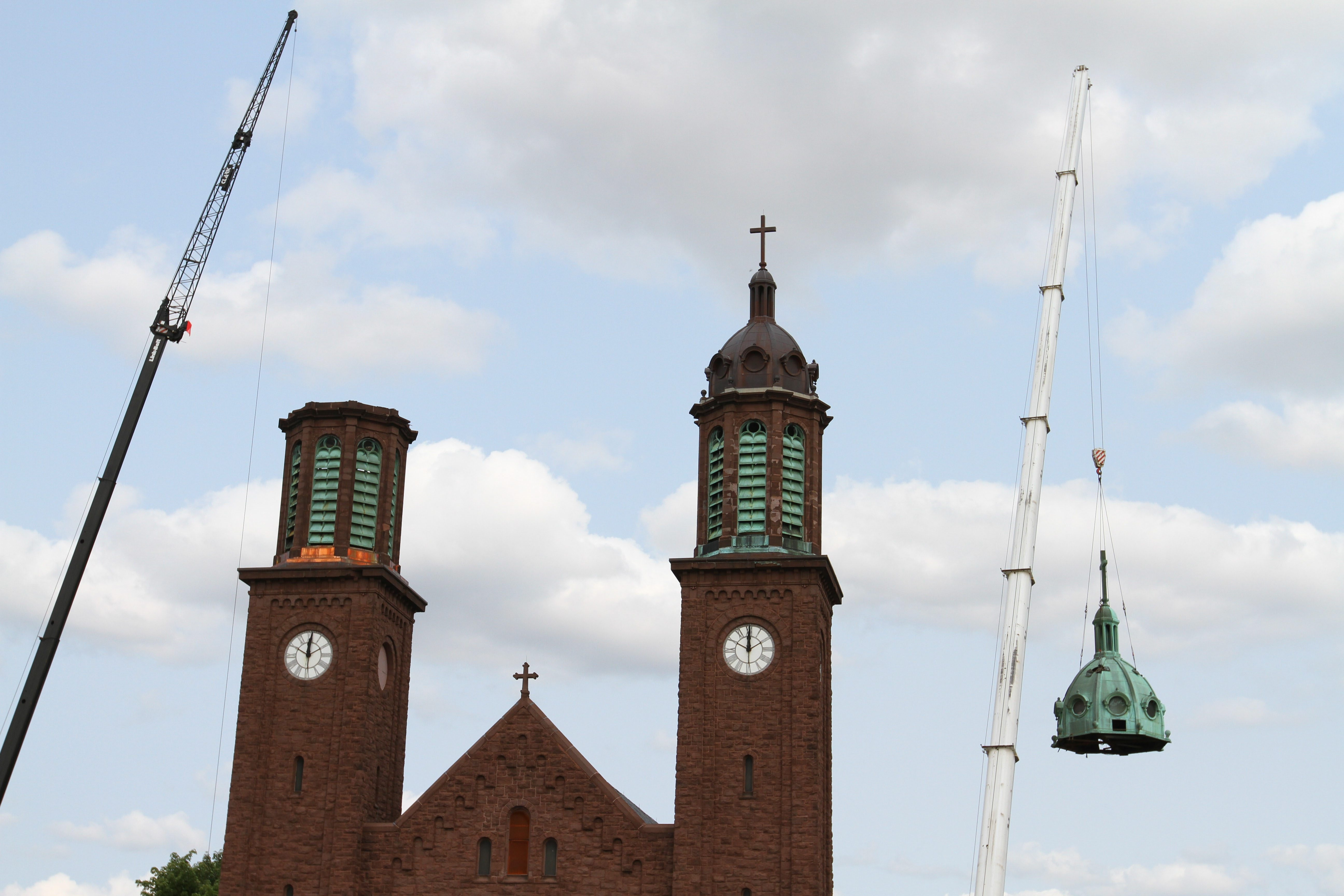 Crews work on removing one of the domes on Corpus Christi Church in Buffalo on Aug. 8. (Mark Mulville/Buffalo News)