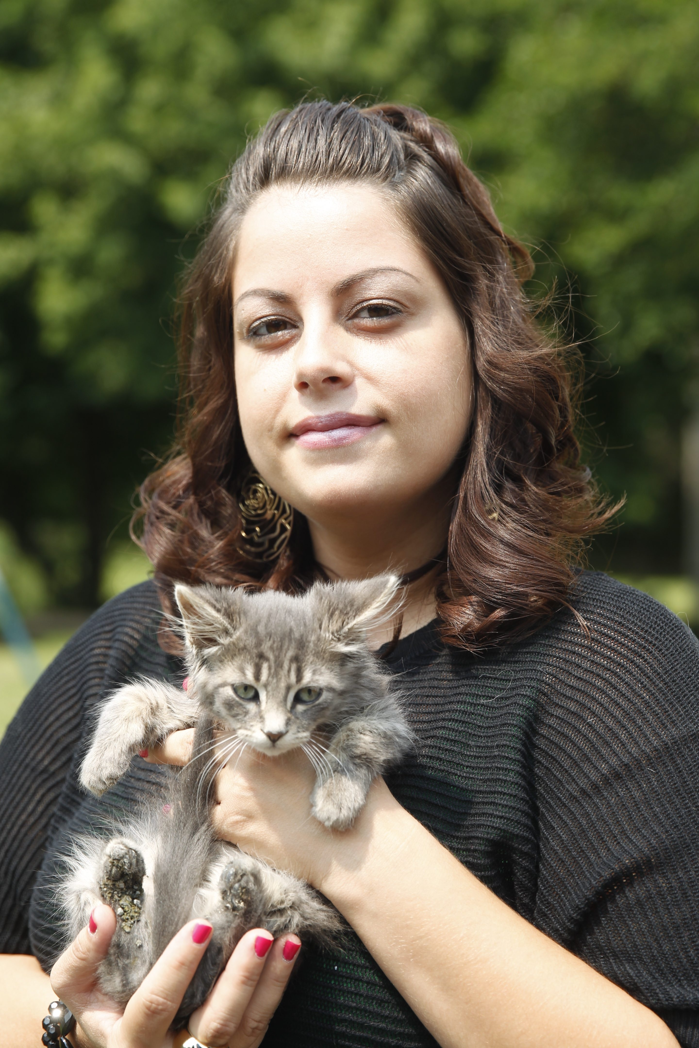 Danielle Coogan holds one of the stray kittens that have been rescued since she began her crusade to curb Tonawanda Island's feral cat population.