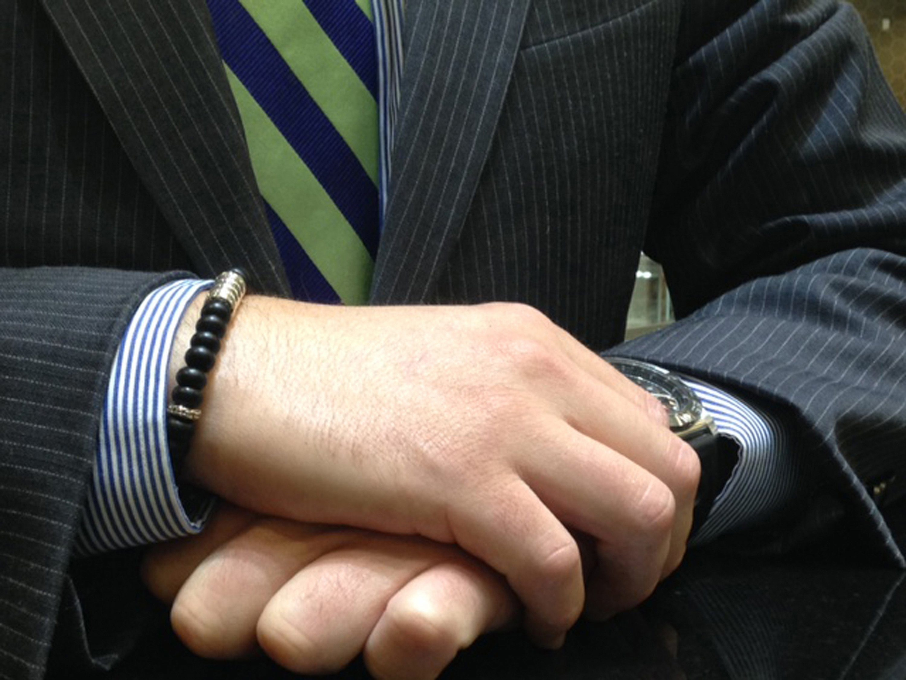 Bracelets for men include a beaded design by John Hardy, left, and a Survival Strap made of 16 feet of paracord to use in emergency situations.