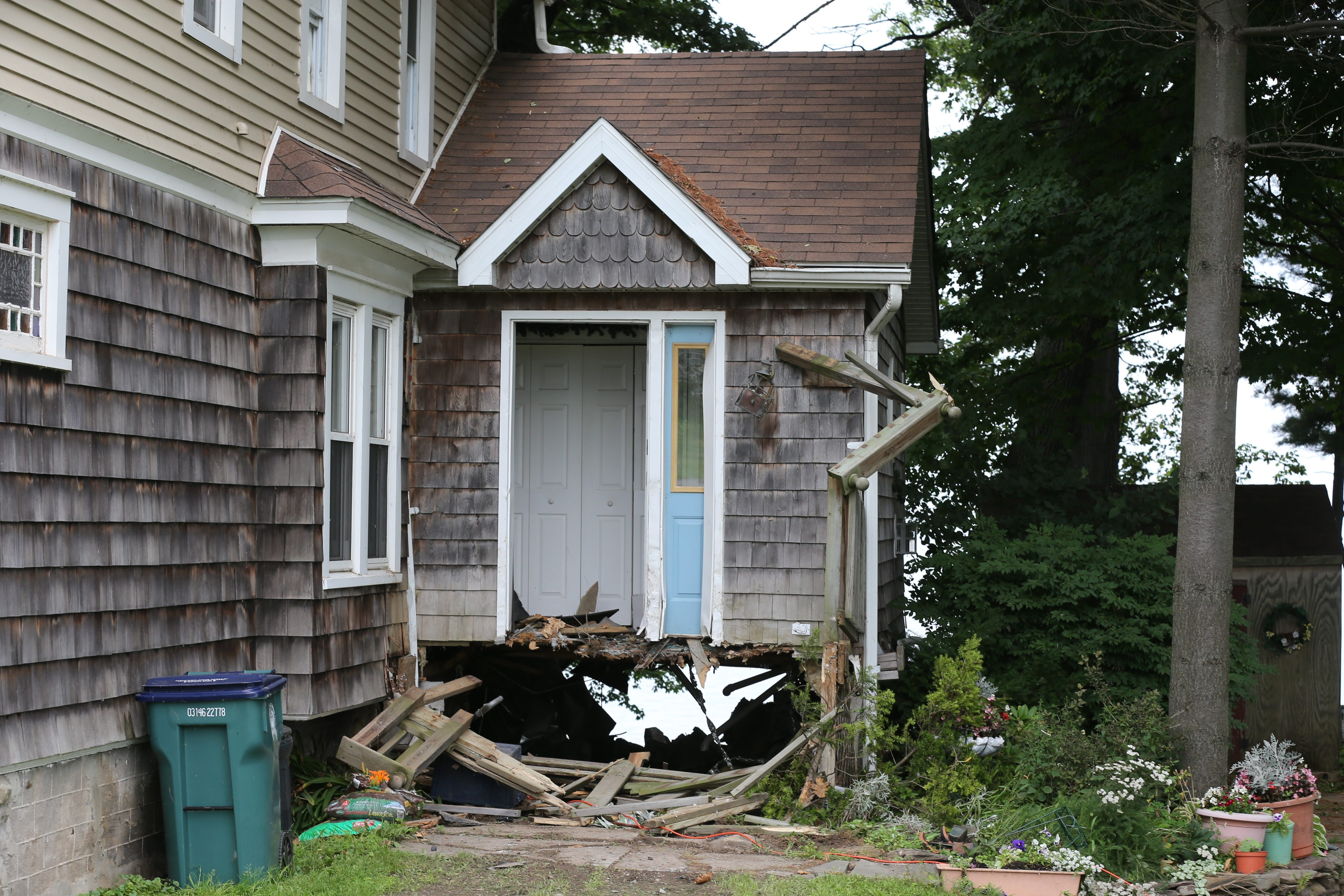 A driver was killed when his Chevrolet Corvette crashed and went through a porch and this home on Route 18 in Burt on Tuesday morning.