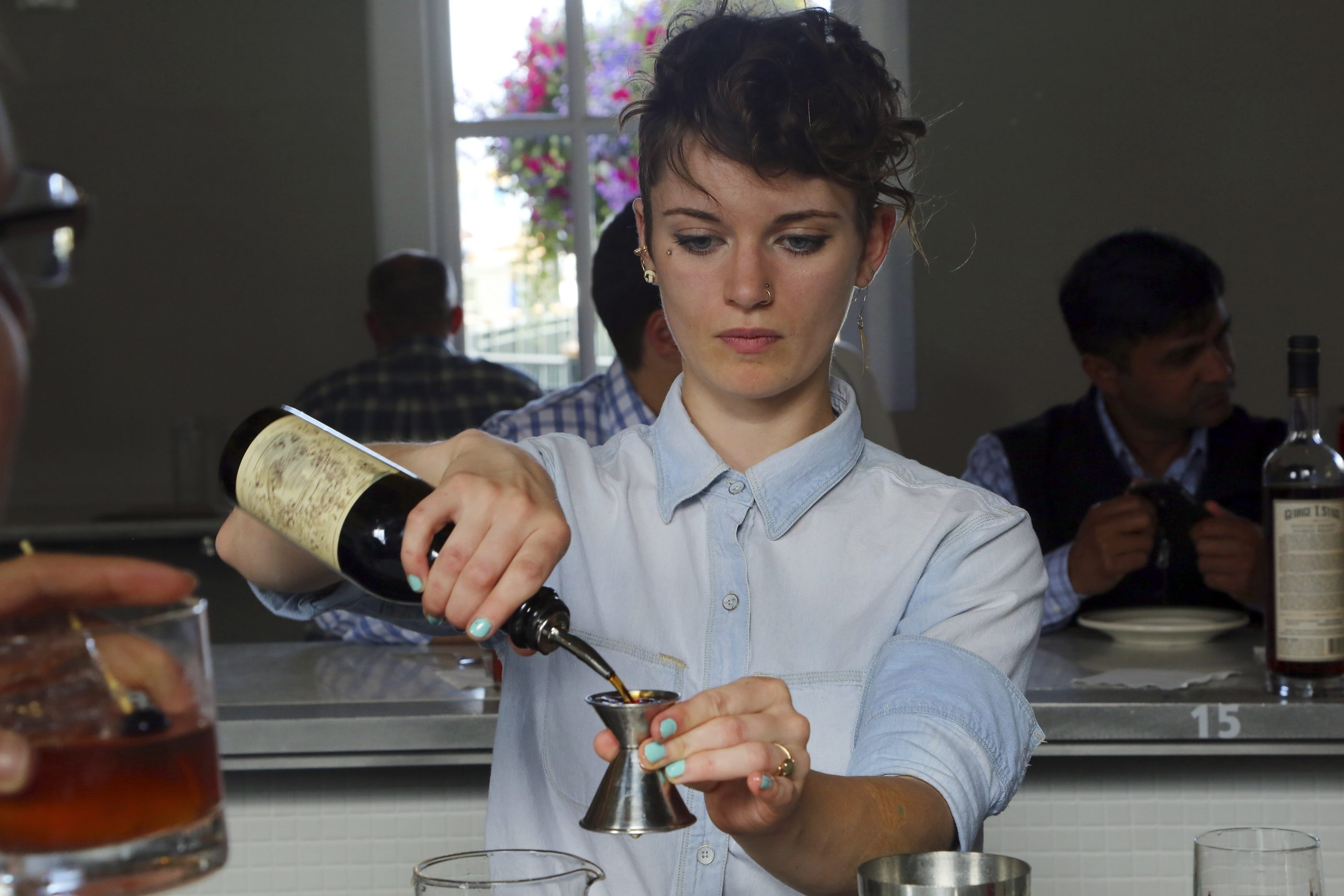 Erin Rose makes a whiskey drink at Hard Water, a whiskey bar, in San Francisco, July 2, 2014. The United States' growing thirst for rare, vintage and high end whiskeys has spawned a niche of whiskey bars with massive collections of hard-to-find spirits. (Jim Wilson/The New York Times)