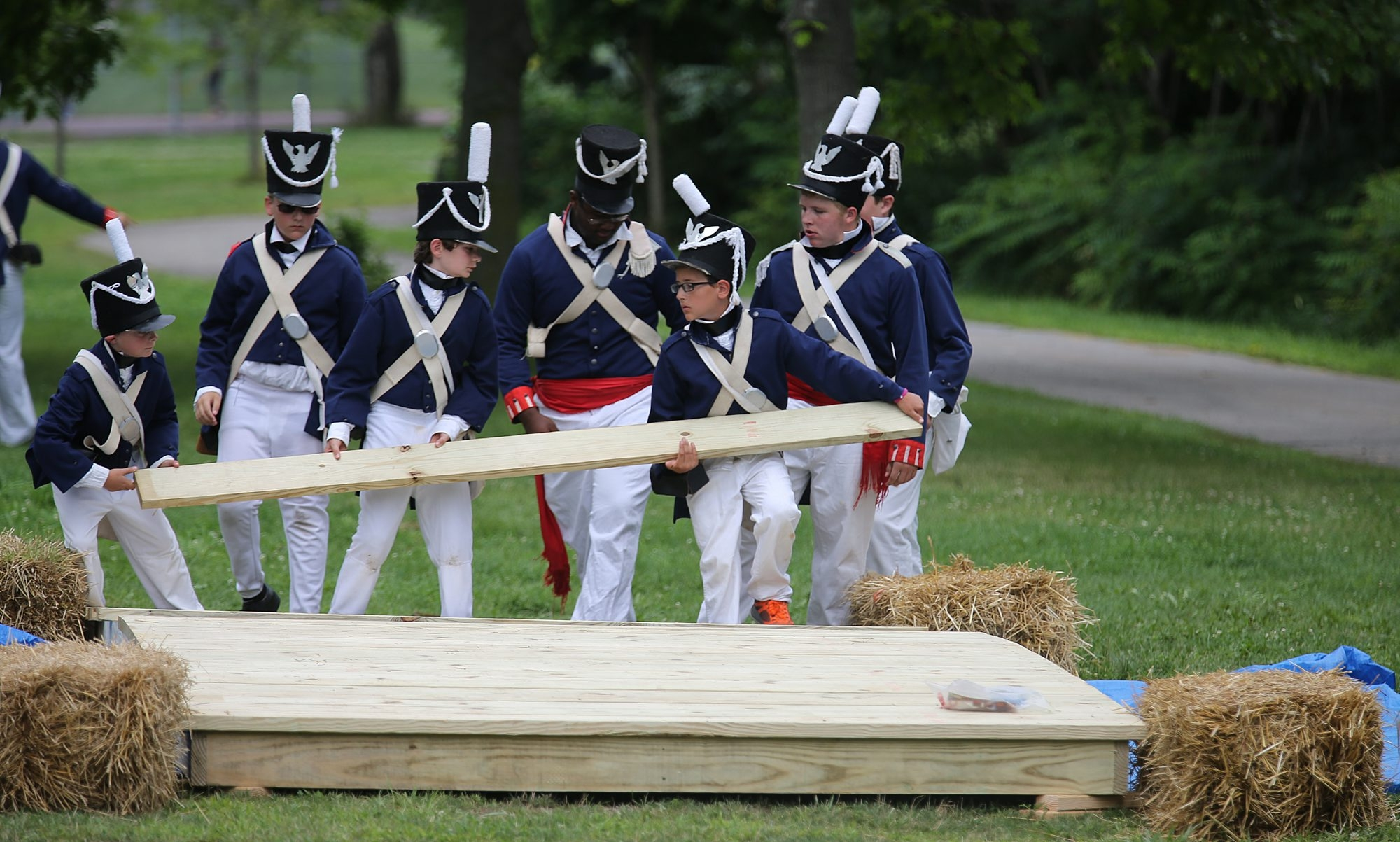 American troops disassemble a replica of the Scajaquada Creek Bridge to foil advancing British troops during a re-enactment of a famous battle during the War of 1812 on Sunday.