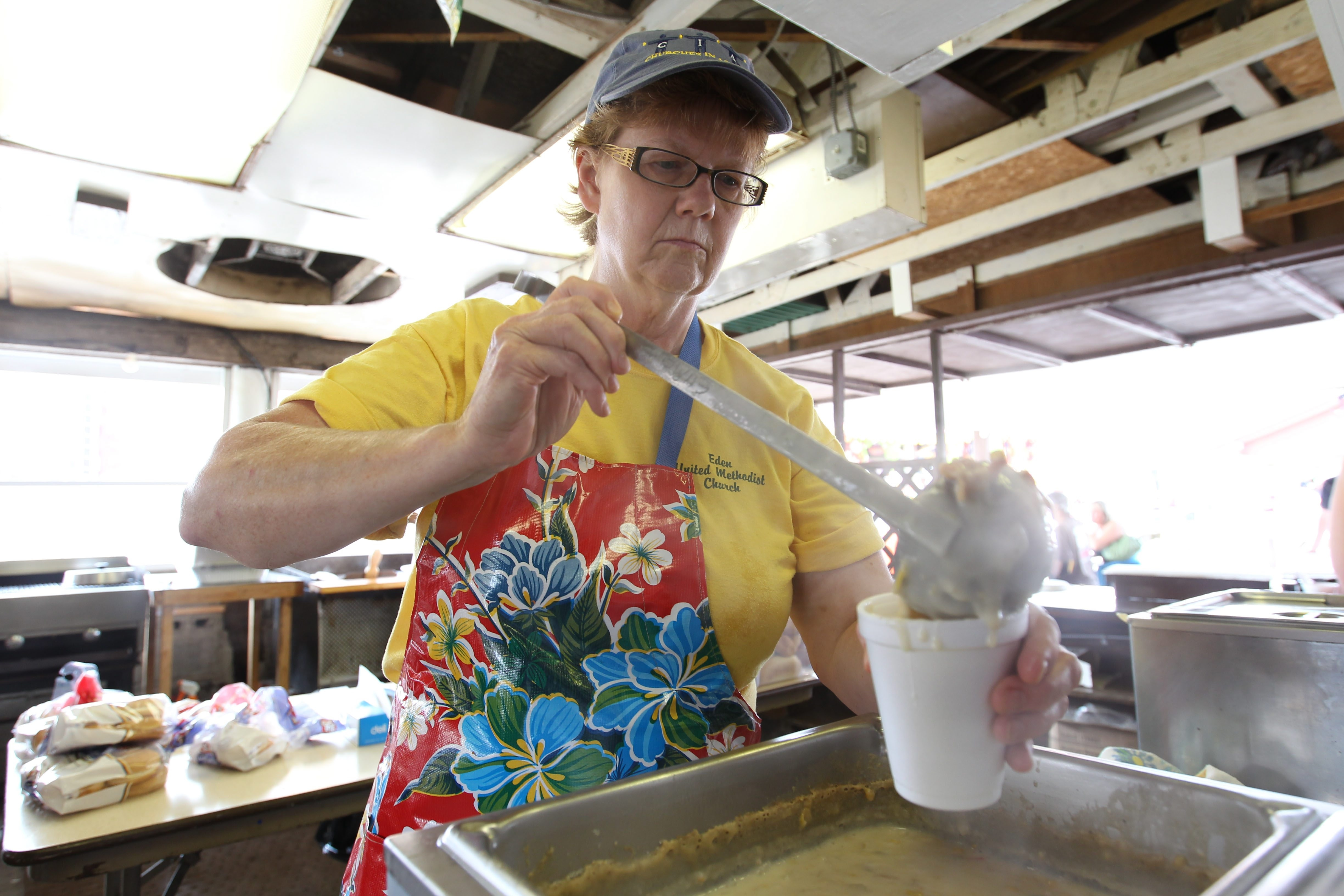 Sue Roseman serves up some traditional corn chowder at the Eden United Methodist Church stand on Friday, the second day of the Eden Corn Festival.