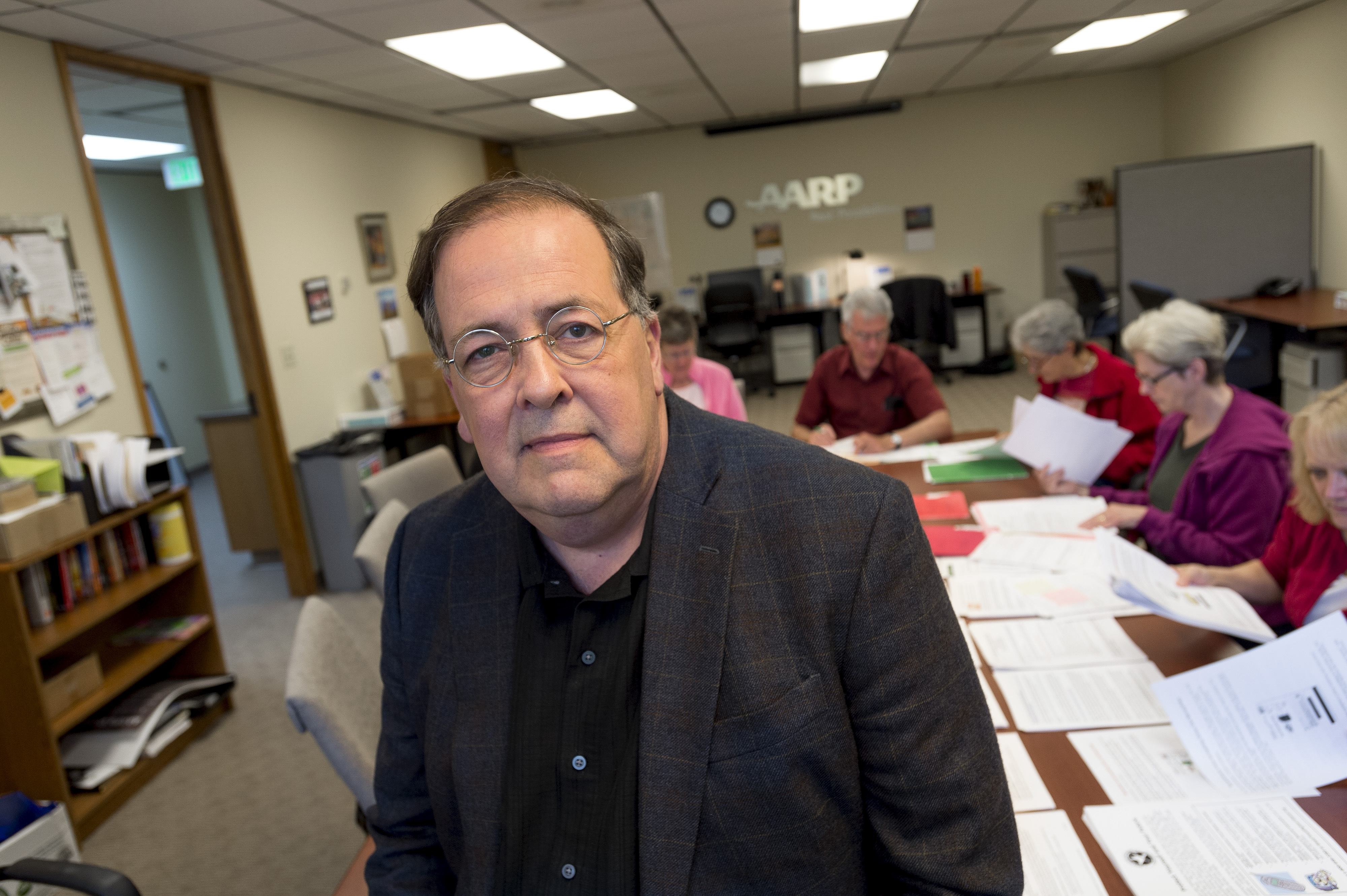 """Doug Shadel, an expert on fraud against the elderly with AARP, is shown at a call center run by the foundation in Seattle. Shadel says that the most valuable asset for any con artist is a list of past victims of fraud – the so-called """"sucker lists"""" that a syndicated newsmagazine recently tried, and failed, to make public."""