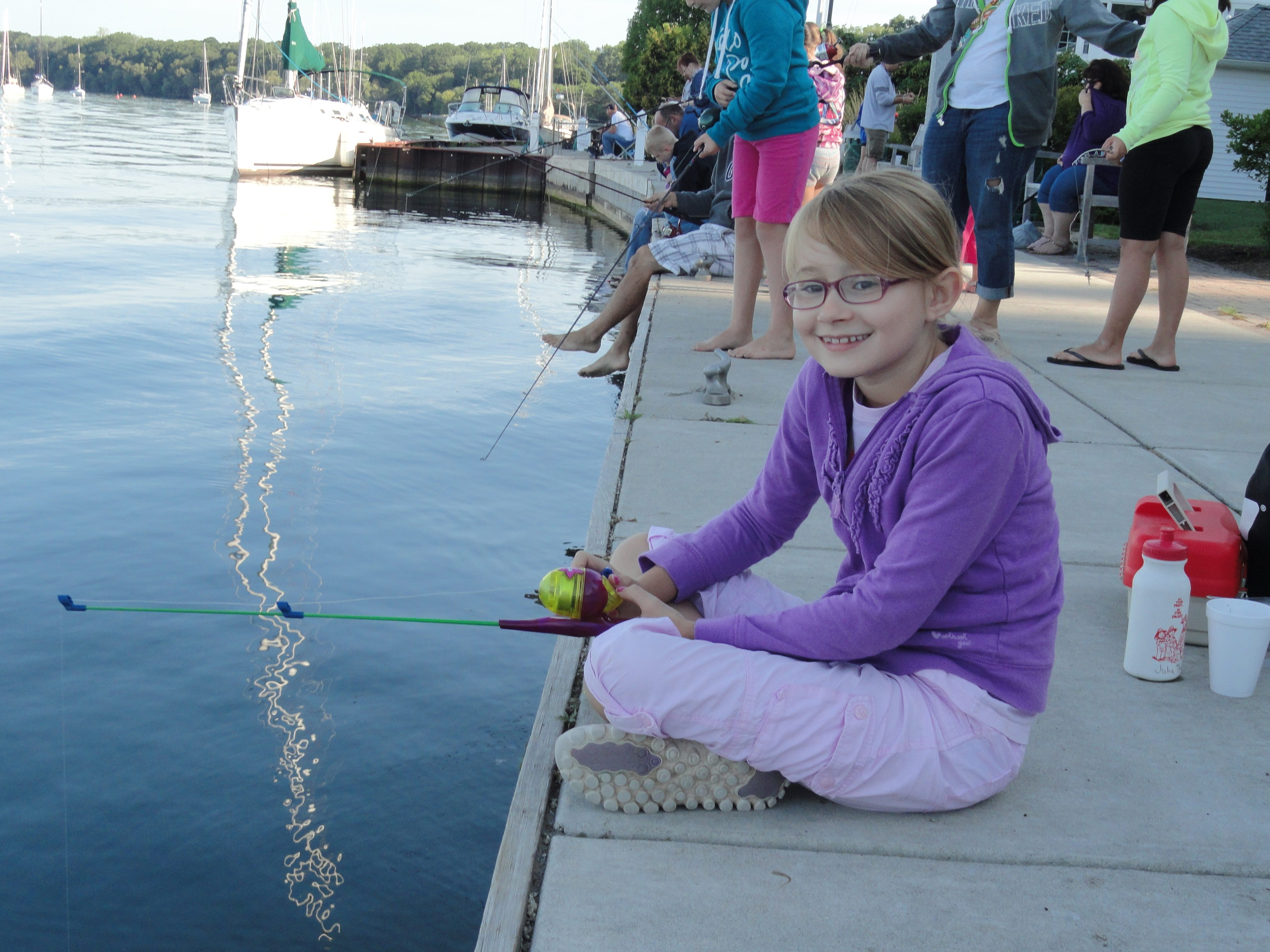 Julia Thomas fishing during last year's Fishing Derby, which is sponsored by the Niagara River Anglers. It is one of many events Saturday in Youngstown.