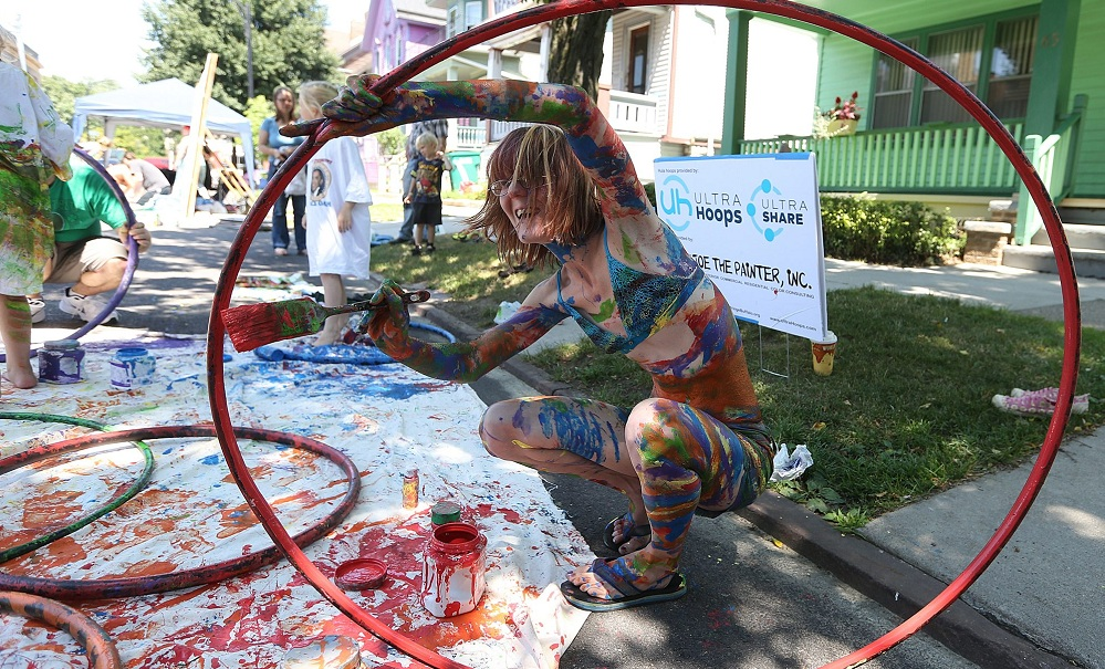 Kathrine Roberts, of Lackawanna, painting a hoop during the 2014 Buffalo Infringement Festival. (Buffalo News file photo)