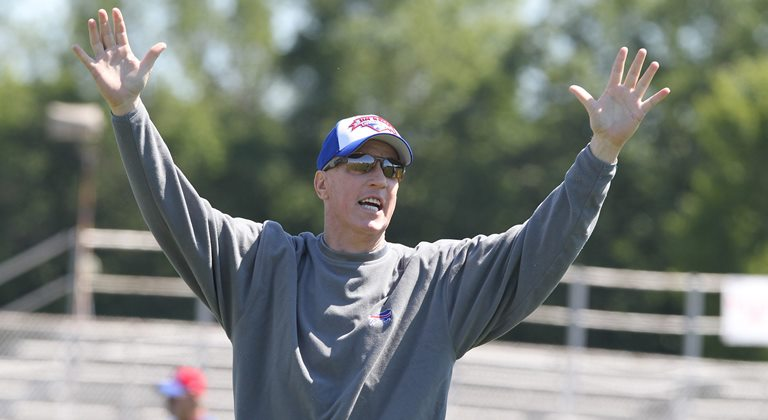 Jim Kelly throws the football during practice with campers at his football camp in July. (James P. McCoy/Buffalo News)
