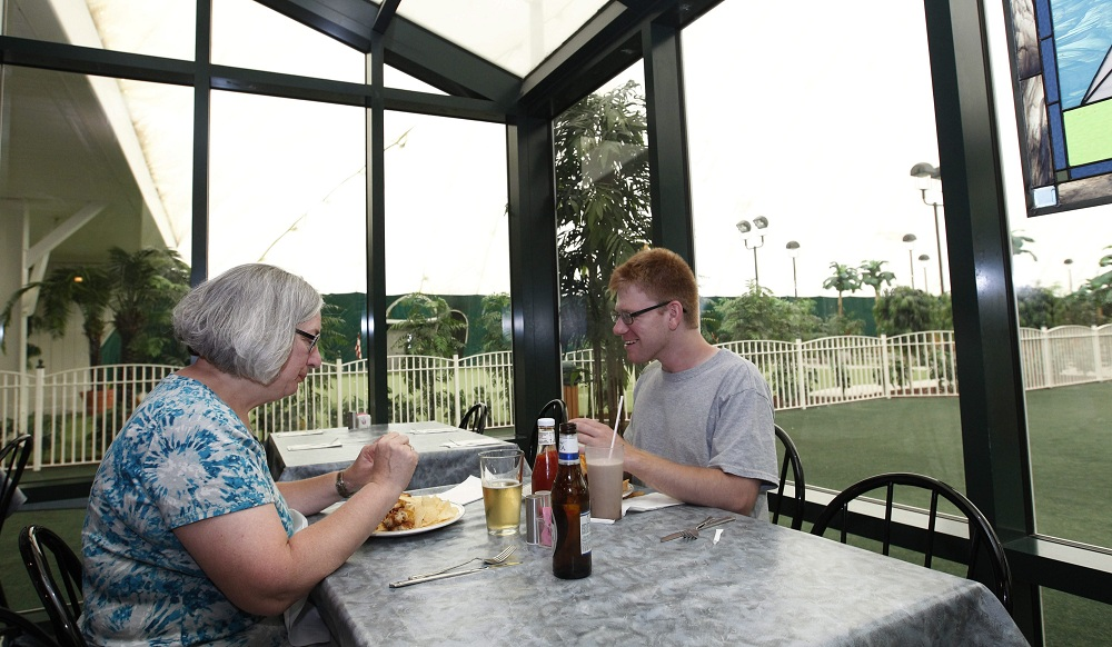 Sue Battaglia and her son, Mike, eat lunch at The Grill @  the Dome in the Town of Tonawanda. (Sharon Cantillon / Buffalo News)
