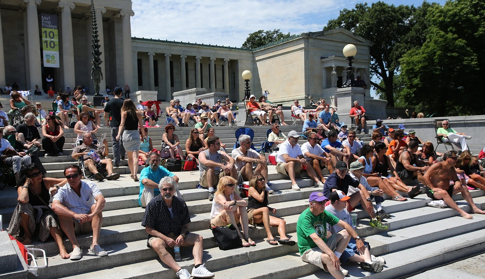 Fans sit on the steps of the Albright-Knox Art Gallery, enjoying summer jazz. Photo from July 6, 2014. (Charles Lewis / Buffalo News file photo)