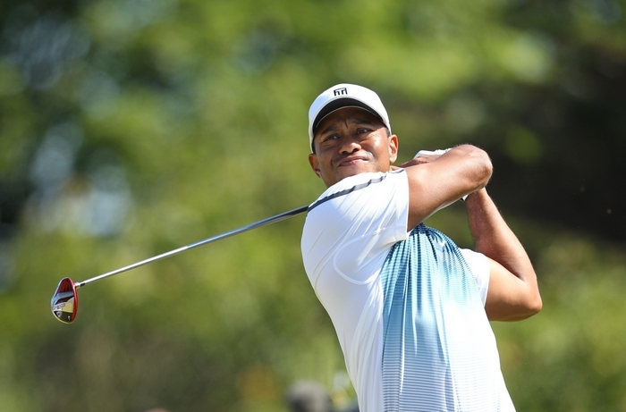 Tiger Woods watches his shot from the eighth tee during his first round 69, on the opening day of the 2014 British Open Golf Championship. (Getty Images).