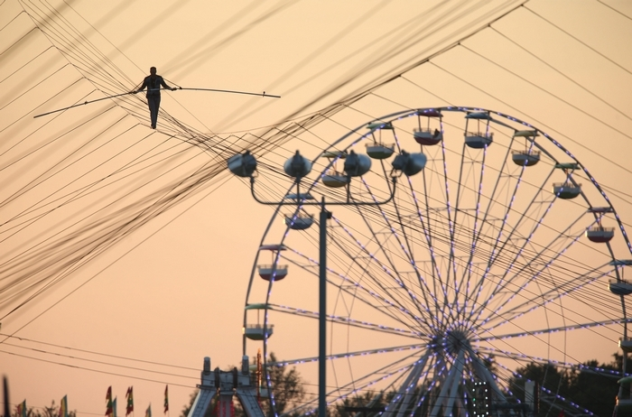 King of the High Wire Nik Wallenda walks on a tightrope over the Erie County Fair in Hamburg on Sunday. (Charles Lewis/Buffalo News)