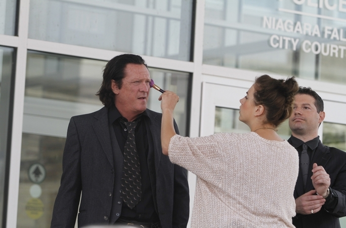 """Michael Madsen, left, gets makeup from Buffalo Hair and Makeup artist Cassandra Lyon as actor Rocky Yavicoli looks on at right. The actors were in Niagara Falls Monday filming """"Q4 Dream Corporation."""" (John Hickey/Buffalo News)"""