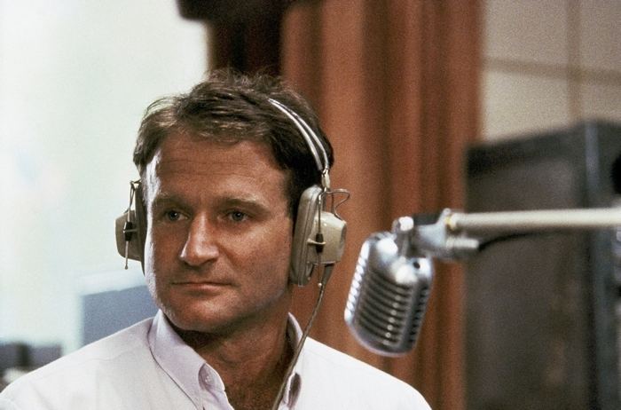 "Actor and comedian Robin Williams appears in character as disc-jockey Adrian Cronauer in director Barry Levinson's 1987 comedy drama, ""Good Morning Vietnam."" (Associated Press file photo)"