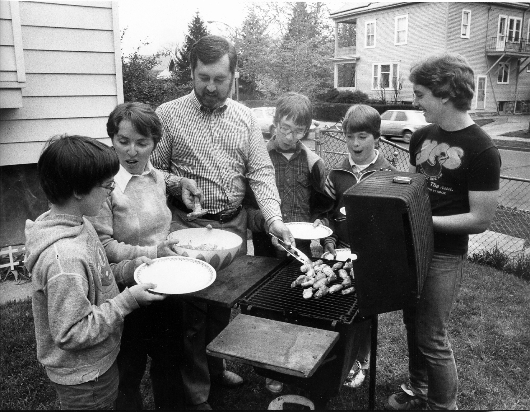 George W. Schaeffer, center, cooks up his award-winning wings in 1984 with, from left, youngest son Dennis, wife Kathleen, and sons Christopher, Jonathan and Michael. (Buffalo News file photo)