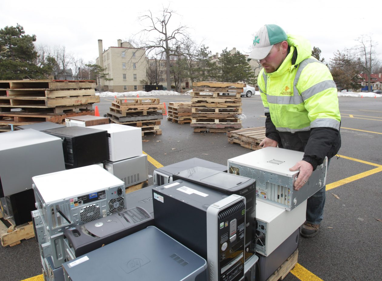 Amherst has scheduled an electronics recycling event for Sept. 22. This 2014 photo shows William Forder of Sunnking stacking donated computers at a recycling event at the Buffalo Zoo. (Sharon Cantillon/News file photo)
