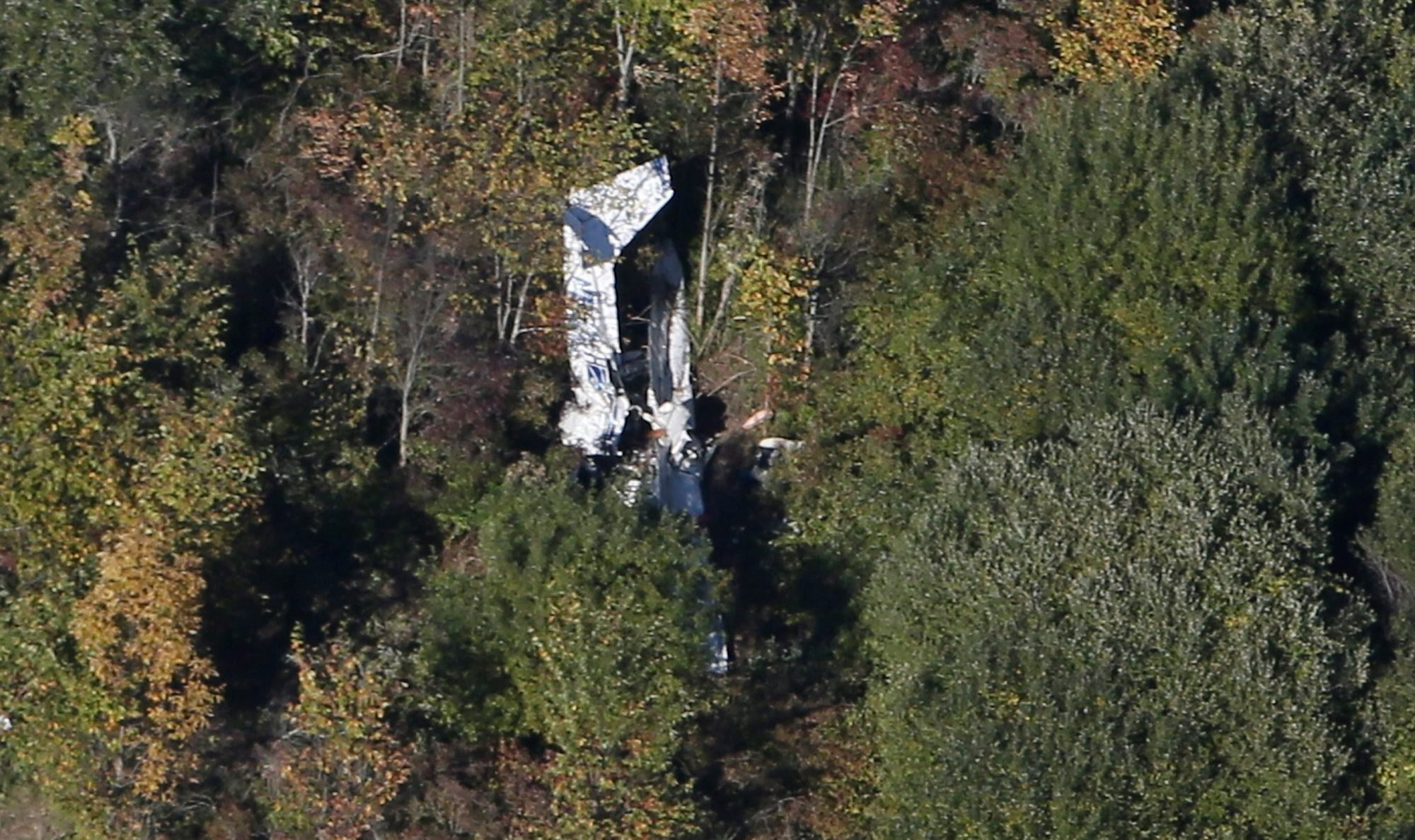 The wreckage of a small plane that crashed in Lancaster after colliding with another plane is seen in this aerial photo Saturday, Sept. 27, 2014 . (John Hickey/Buffalo News)