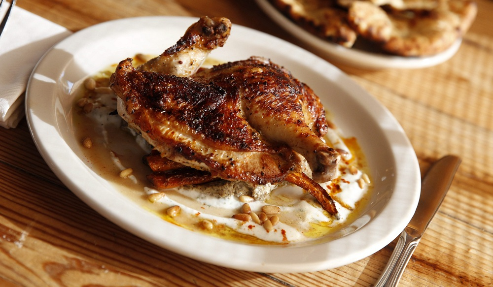 The Moroccan chicken is seasoned with vadouvan, a curry-like spice that is made in-house at Elm Street Bakery. (Sharon Cantillon/Buffalo News file photo)