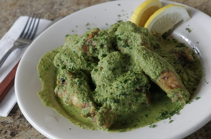 At the Falafel Bar, chicken wings are fried and tossed in a piquant green hot sauce with jalapenos and garlic. (Sharon Cantillon/Buffalo News)