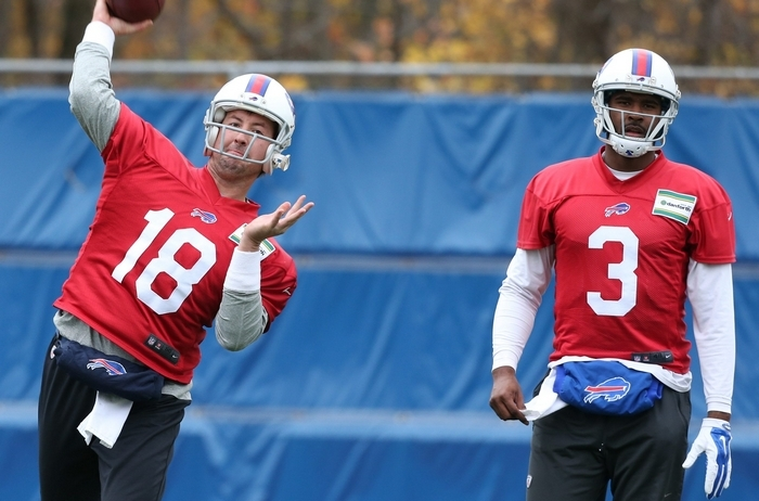 Kyle Orton, left, throwing next to EJ Manuel on Wednesday, needs to stay upright for the Bills to be competitive. (James P. McCoy/Buffalo News)
