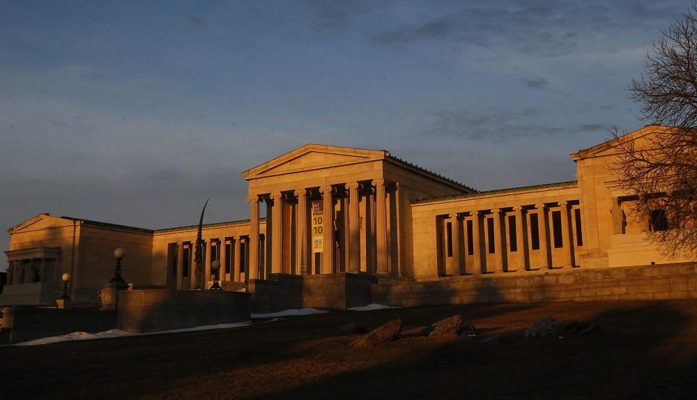 Intense morning light paints the Albright Knox Art Gallery as the sun rises, Tuesday, April 1, 2014.  (Derek Gee/Buffalo News)