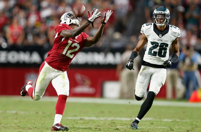 Cardinals receiver John Brown reaches for the catch on a 75-yard touchdown past Cary Williams of the Eagles. (Getty Images)