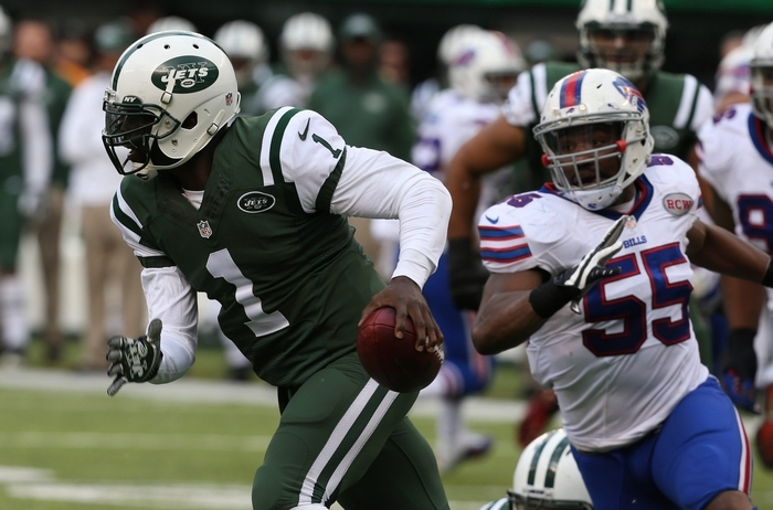 Jets quarterback Michael Vick ran five times for 57 yards in the first half. (James P. McCoy/Buffalo News)