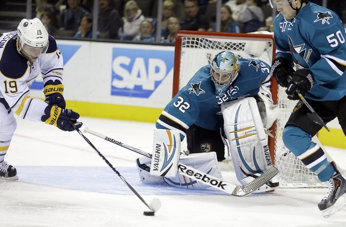 Sabres' Cody Hodgson, left, maneuvers the puck before scoring against San Jose Sharks goalie Alex Stalock (32) in a game Saturday won by Buffalo. It was Hodgson's first goal of the season, coming in the team's ninth game. (Associated Press)