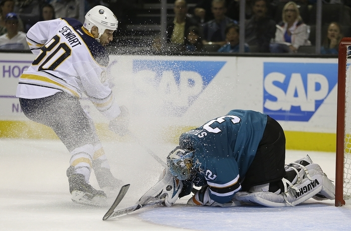 San Jose Sharks goalie Alex Stalock, right, blocks a shot by Sabres' Chris Stewart  in a game the Sabres won 2-1 Saturday. Stewart, along with Matt Moulson, Drew Stafford and Brian Gionta, has yet to score a goal this season.