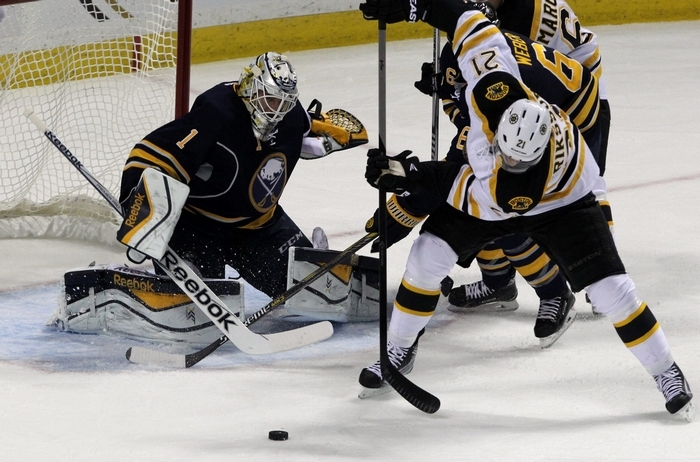 Buffalo Sabres goalie Jhonas Enroth (1) battles Boston Bruins left winger Loui Eriksson (21) for the puck in the first period at First Niagara Center in Buffalo on Thursday, Oct. 30, 2014.  (James P. McCoy/ Buffalo News)