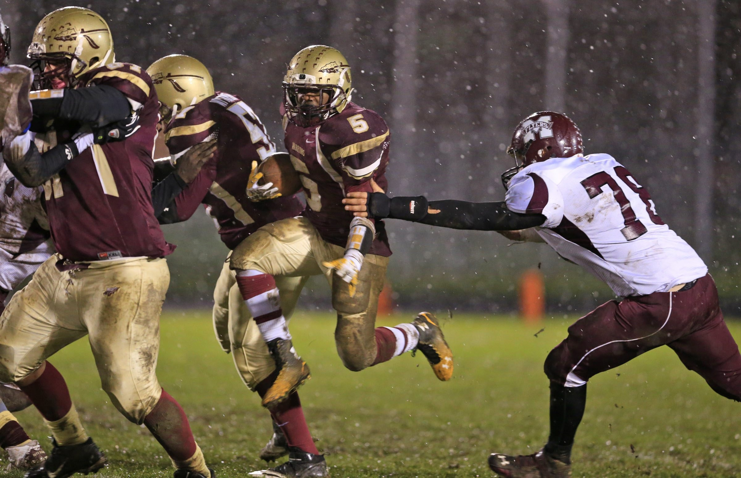 Cheektowaga's Marshawn Gibson leaps through a hole in Saturday night's game with Maryvale.