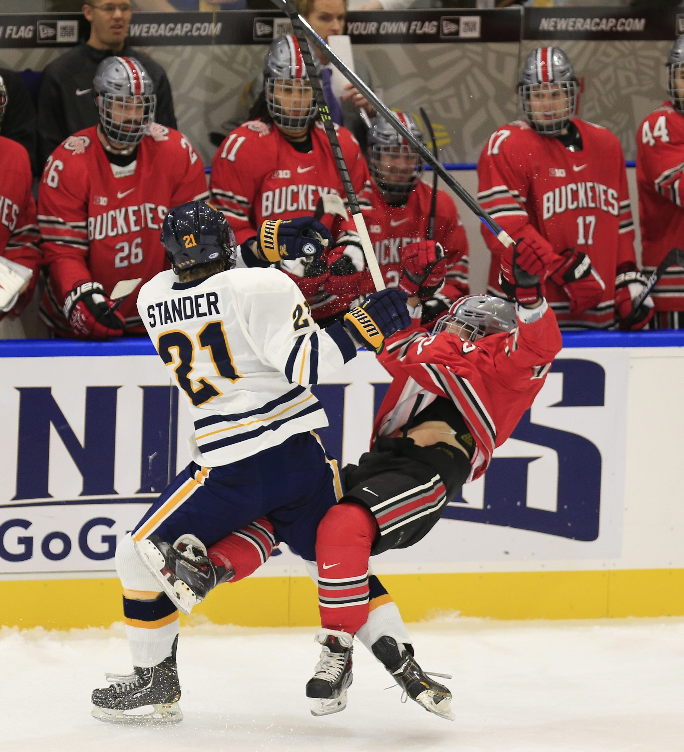 Canisius' Jack Stander catches Ohio State's Chad Niddery with a mid-ice check during first-period action at HarborCenter.