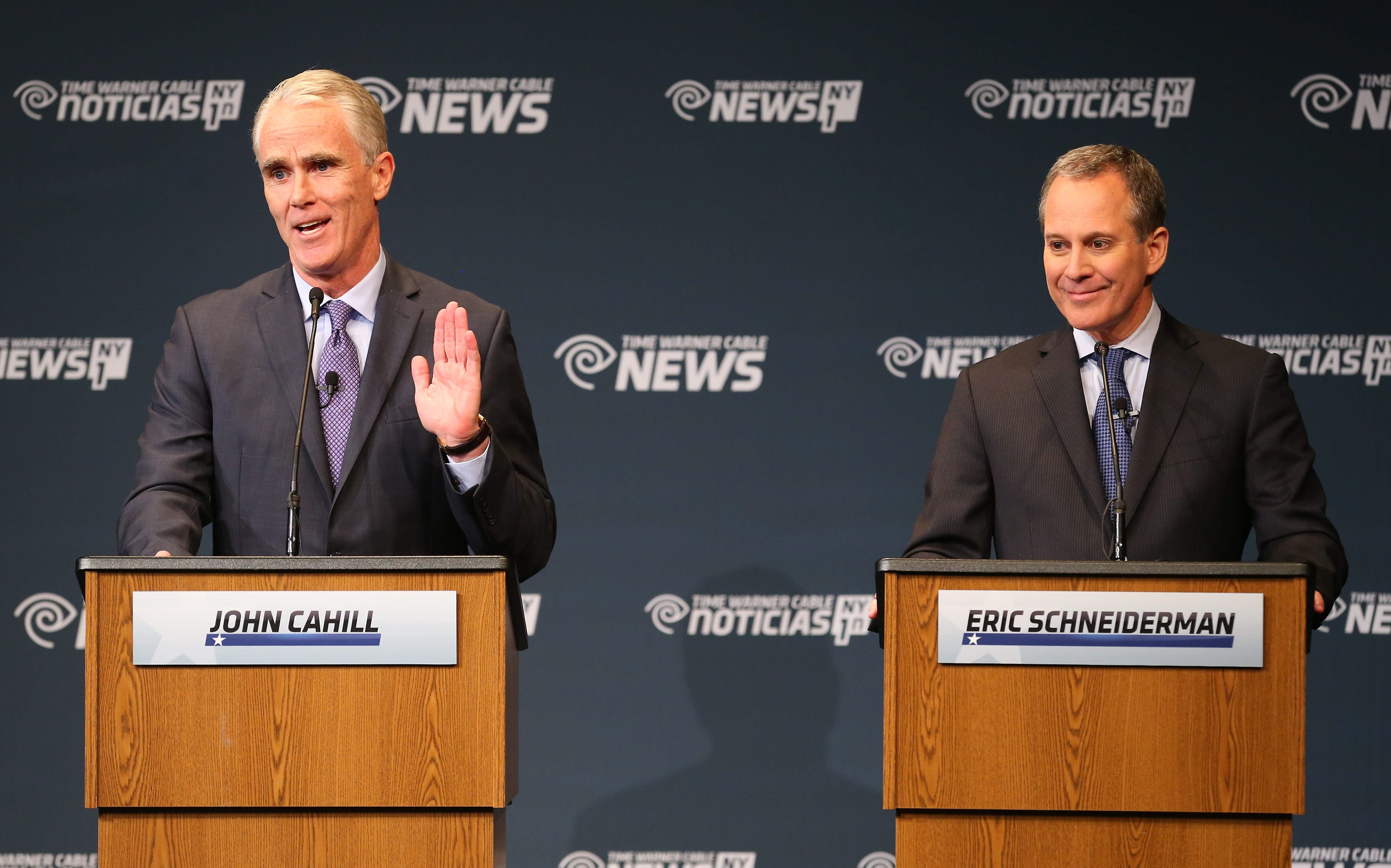 Attorney general candidate John P. Cahill makes a point to incumbent Eric T. Schneiderman during the debate at Hilbert College in Hamburg on Thursday evening.