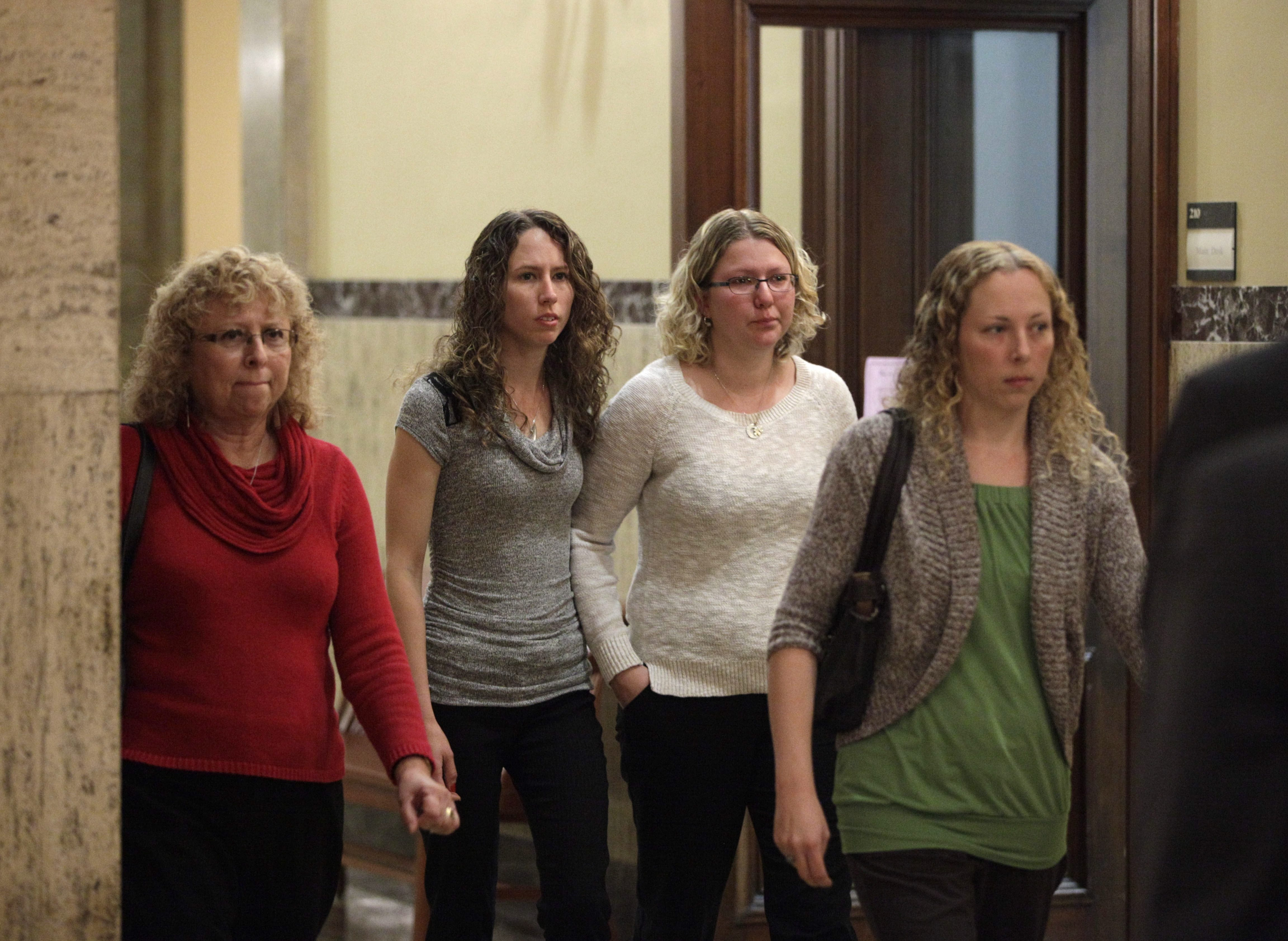 From left, Karen Wielinski and her daughters, Jessica Krill, Jill Hohl and Kim Lipiarz arrive for their final court appearance after reaching a settlement in the midst of their trial against the operators of Continental Connection Flight 3407, Thursday, Oct. 30, 2014. (Derek Gee/Buffalo News)
