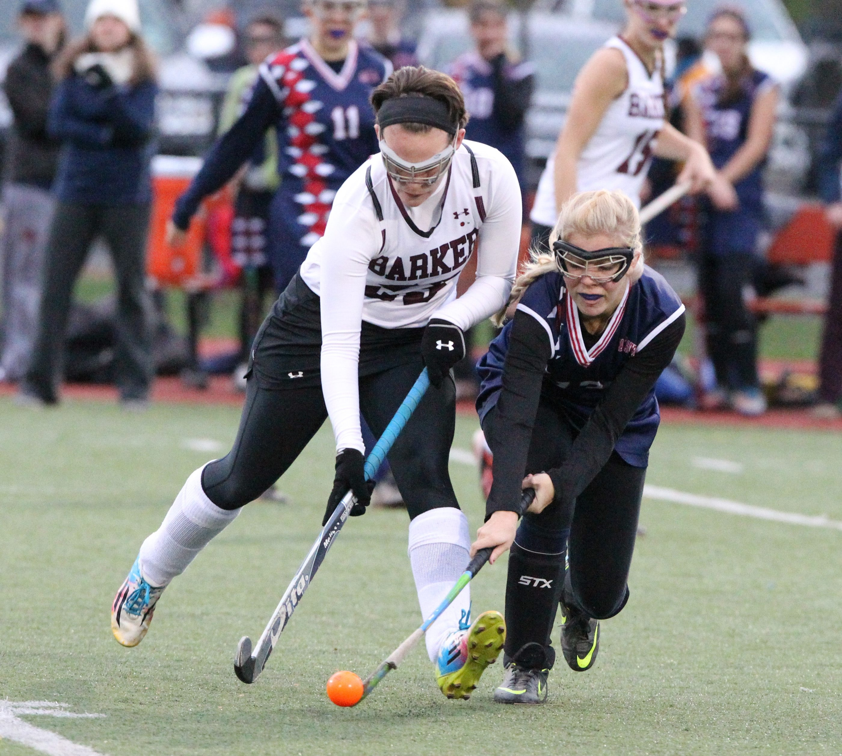 Barker's Melissa Grosshans and East Aurora's Dana Reger go after the ball during Thursday's Class C field hockey semifinal.