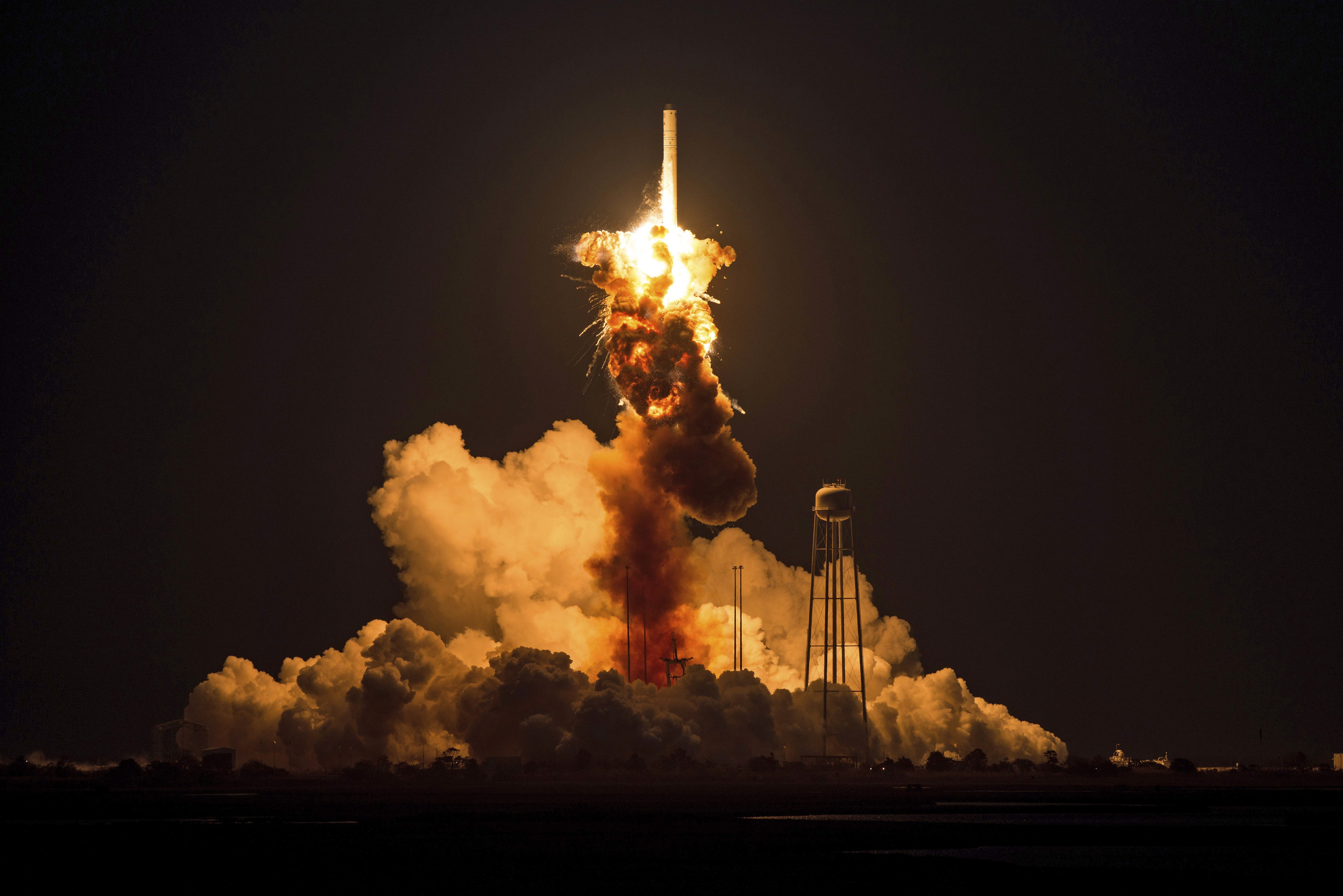 An unmanned Antares rocket explodes seconds after liftoff at NASA's Wallops Flight Facility in Virginia on Tuesday.
