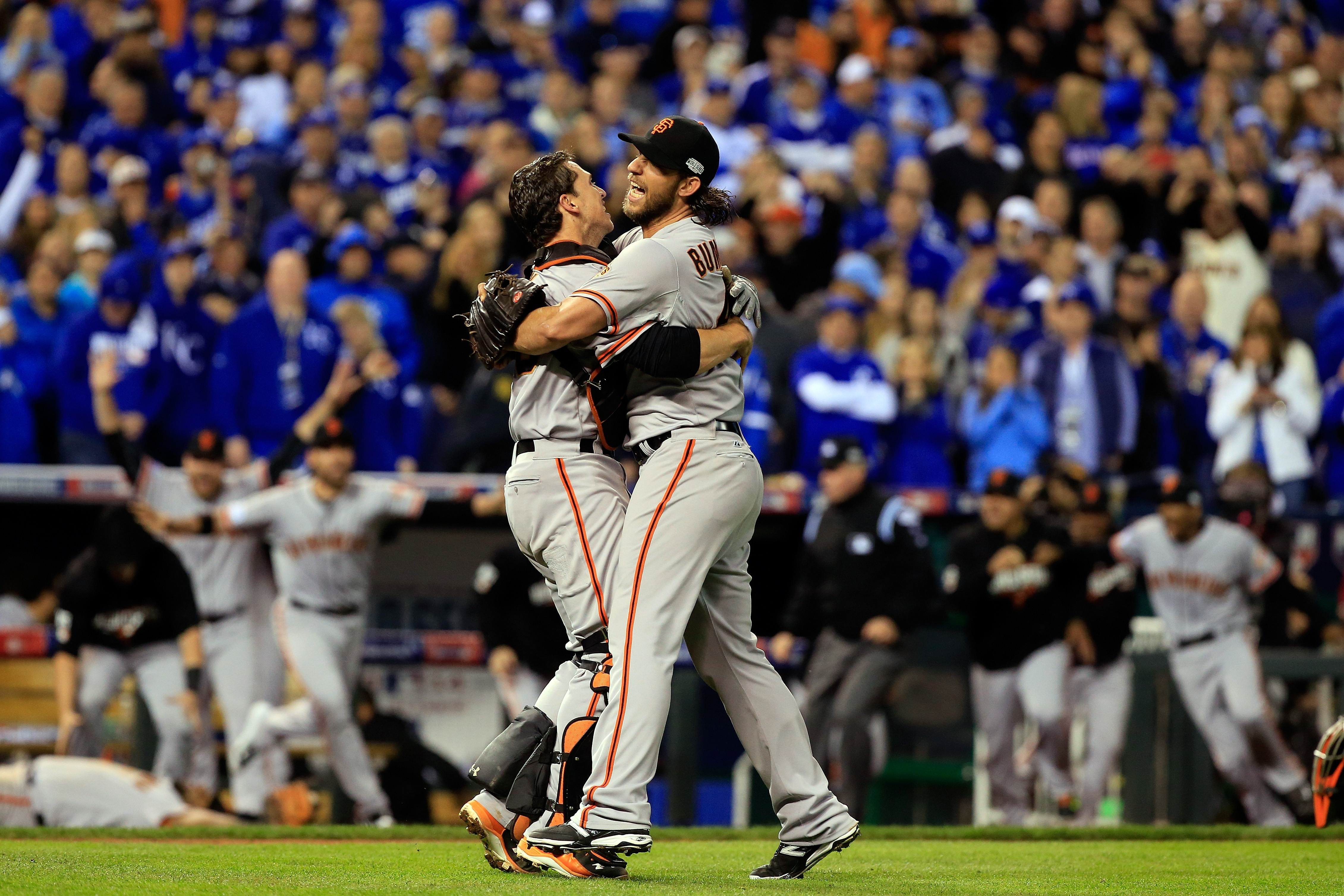 Giants catcher Buster Posey and Madison Bumgarner celebrate after defeating the Royals to win Game Seven of the 2014 World Series, 3-2.