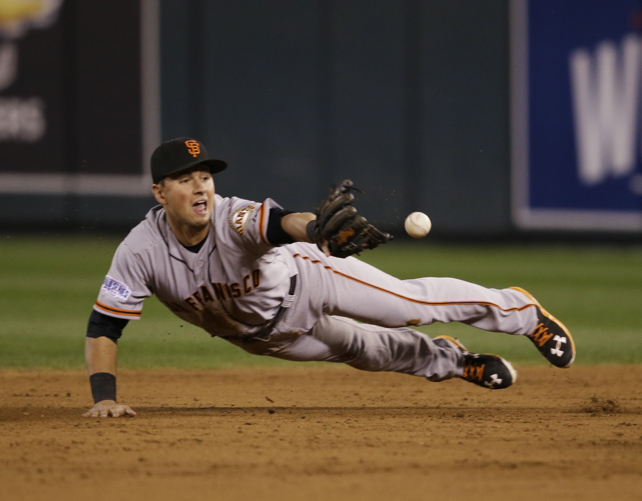 Giants second baseman Joe Panik flips the ball to Brandon Crawford to start a double play that needed a replay.