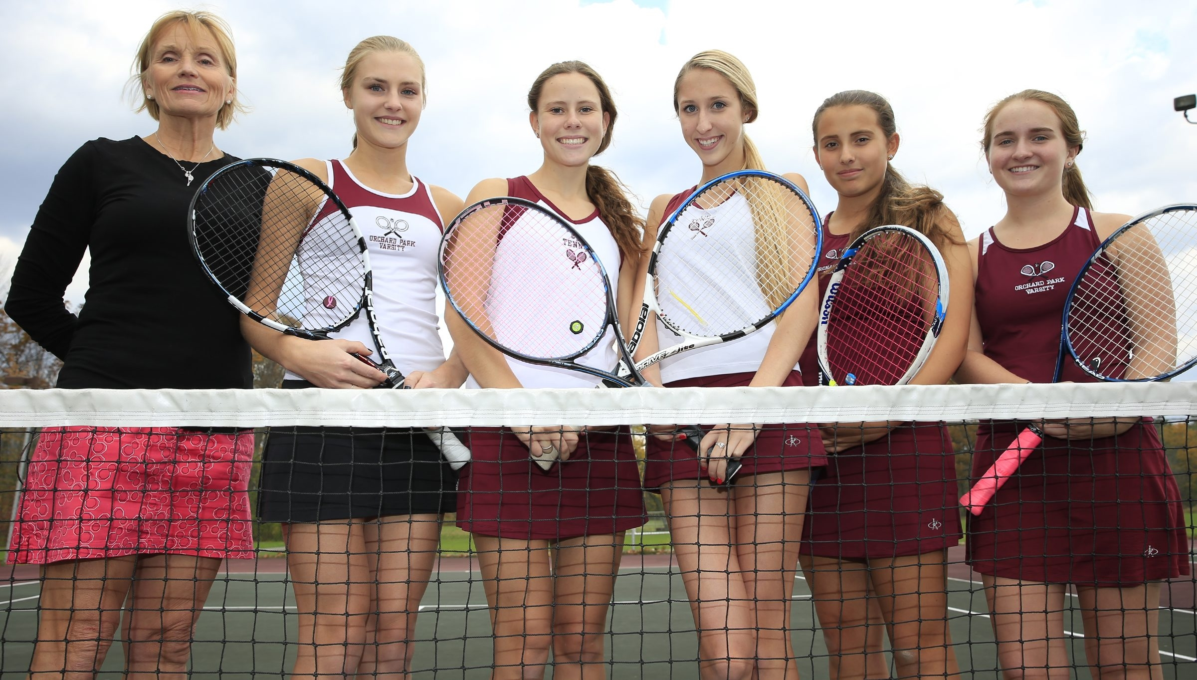 From left, Orchard Park tennis coach Sandy Trampert with the five members of her team going to the state championships: Haley Hollins, Rachel Johnson, Shayleen Brennan, Lauren Karoglan and Kristen Zablonski.