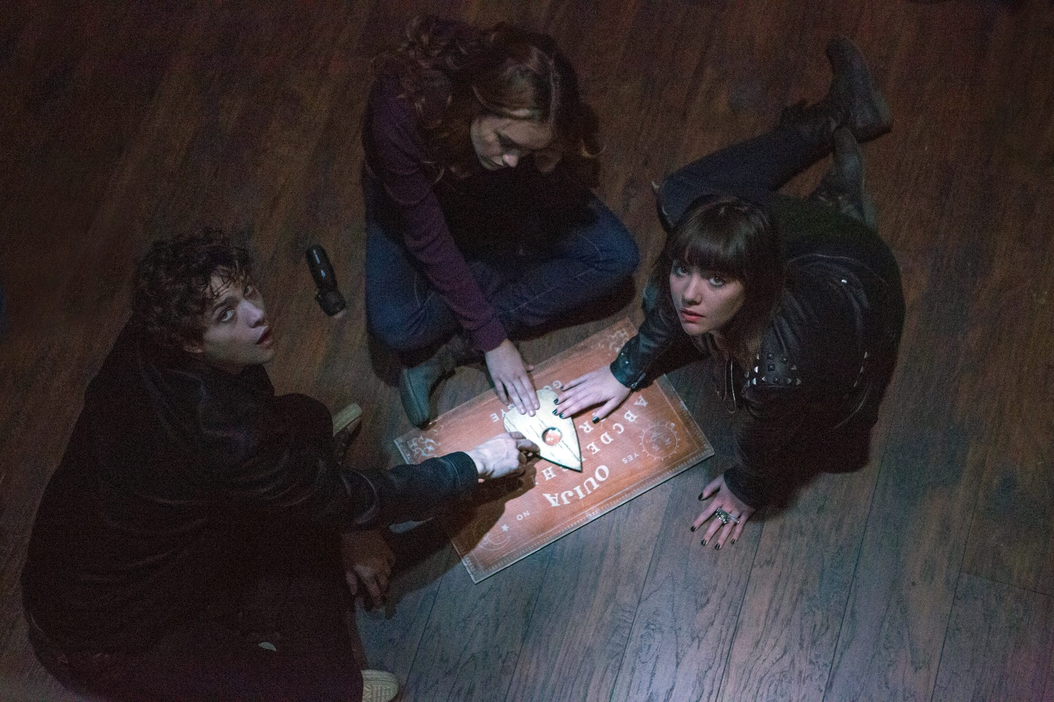 "From left, Douglas Smith, Olivia Cooke and Ana Coto star in ""Ouija,"" a supernatural thriller about a group of friends who must confront their most terrifying fears when they awaken the dark powers of an ancient spirit."