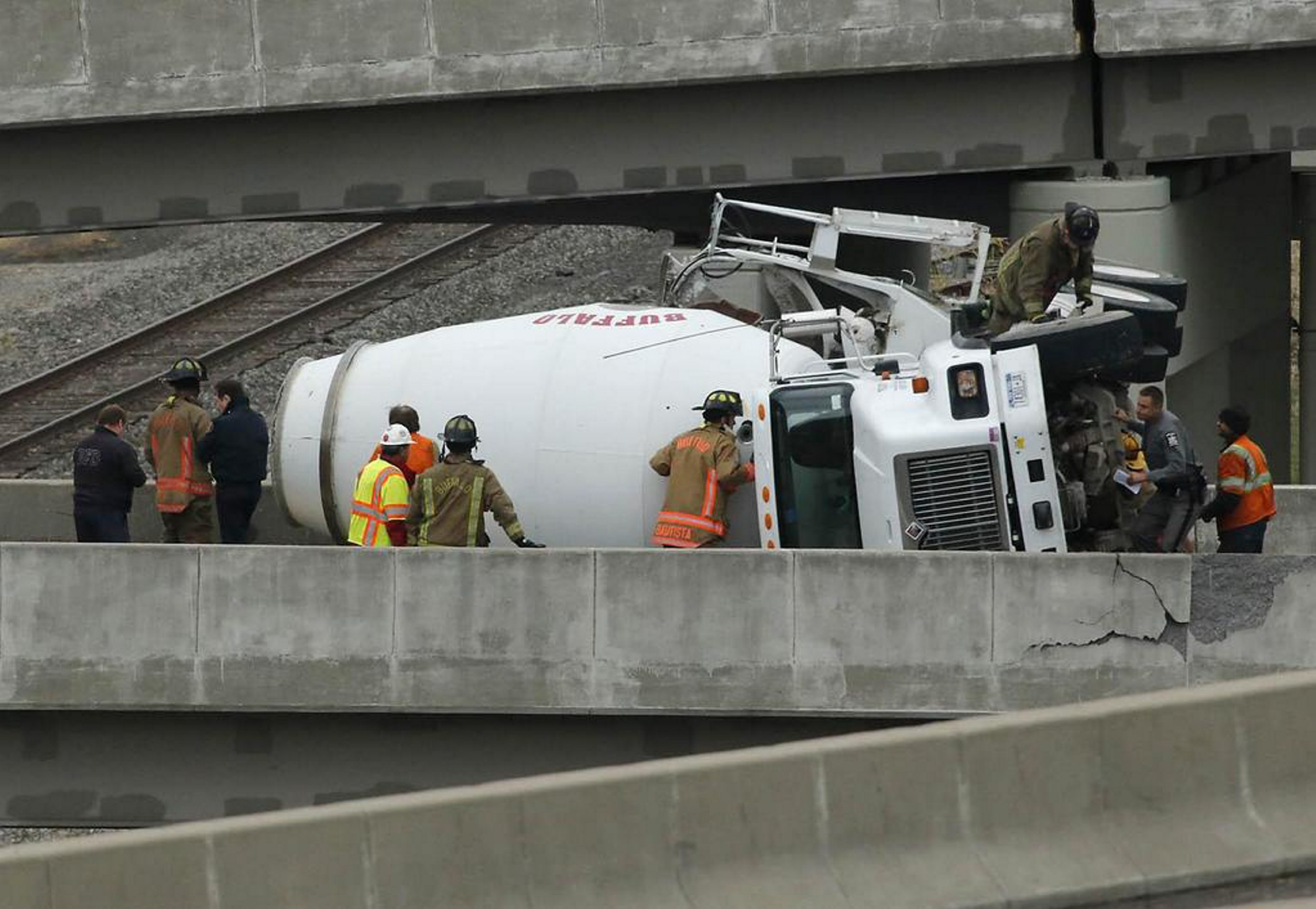 Rescue crews respond to a cement truck that rolled over on the Elm Street exit from the I-190 south, Wednesday, Oct. 29, 2014. (Derek Gee/Buffalo News)
